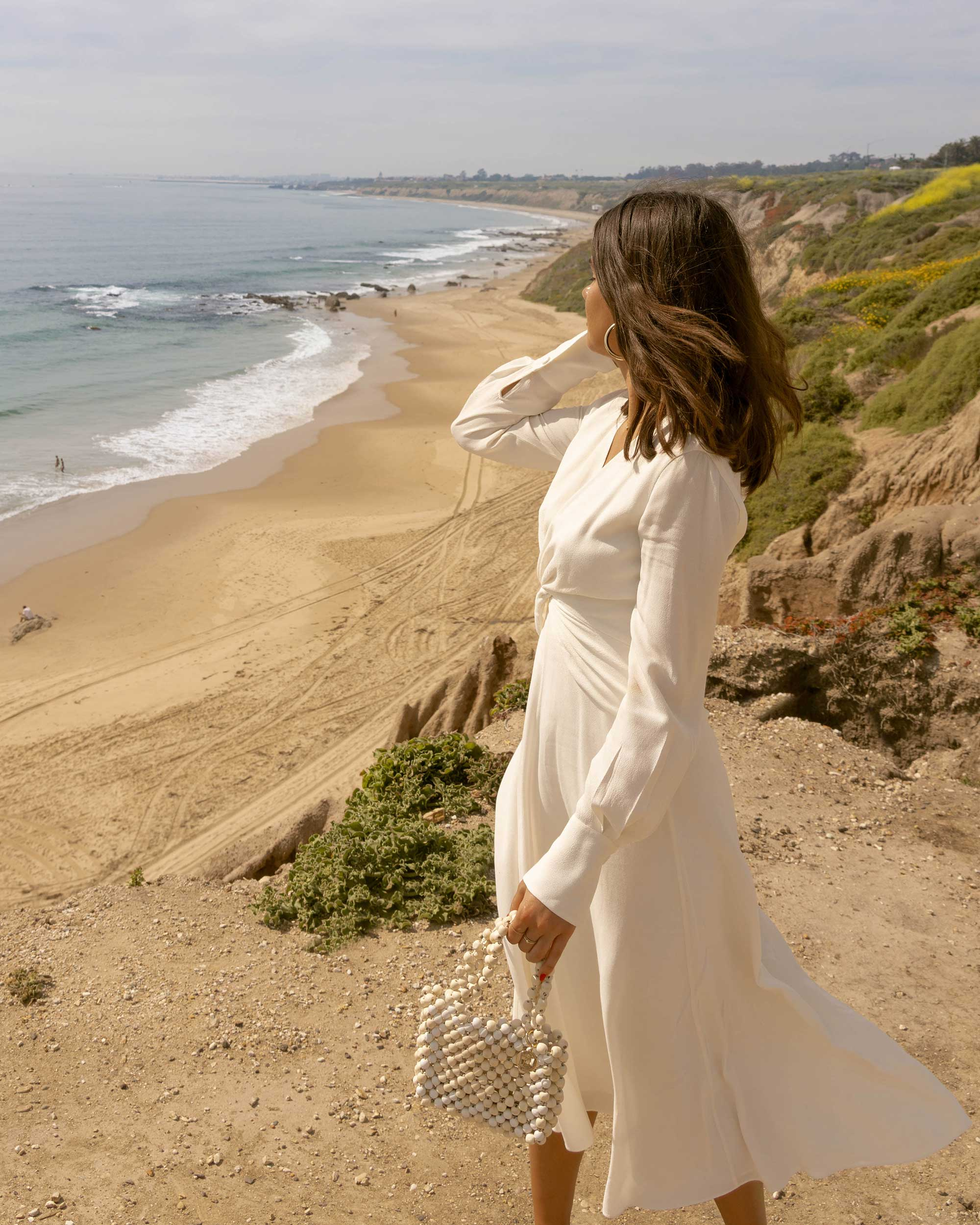White Dress in Laguna - Equipment Faun crepe midi dress in white with a flatteringly knotted front and plunging neckline for the perfect spring outfit