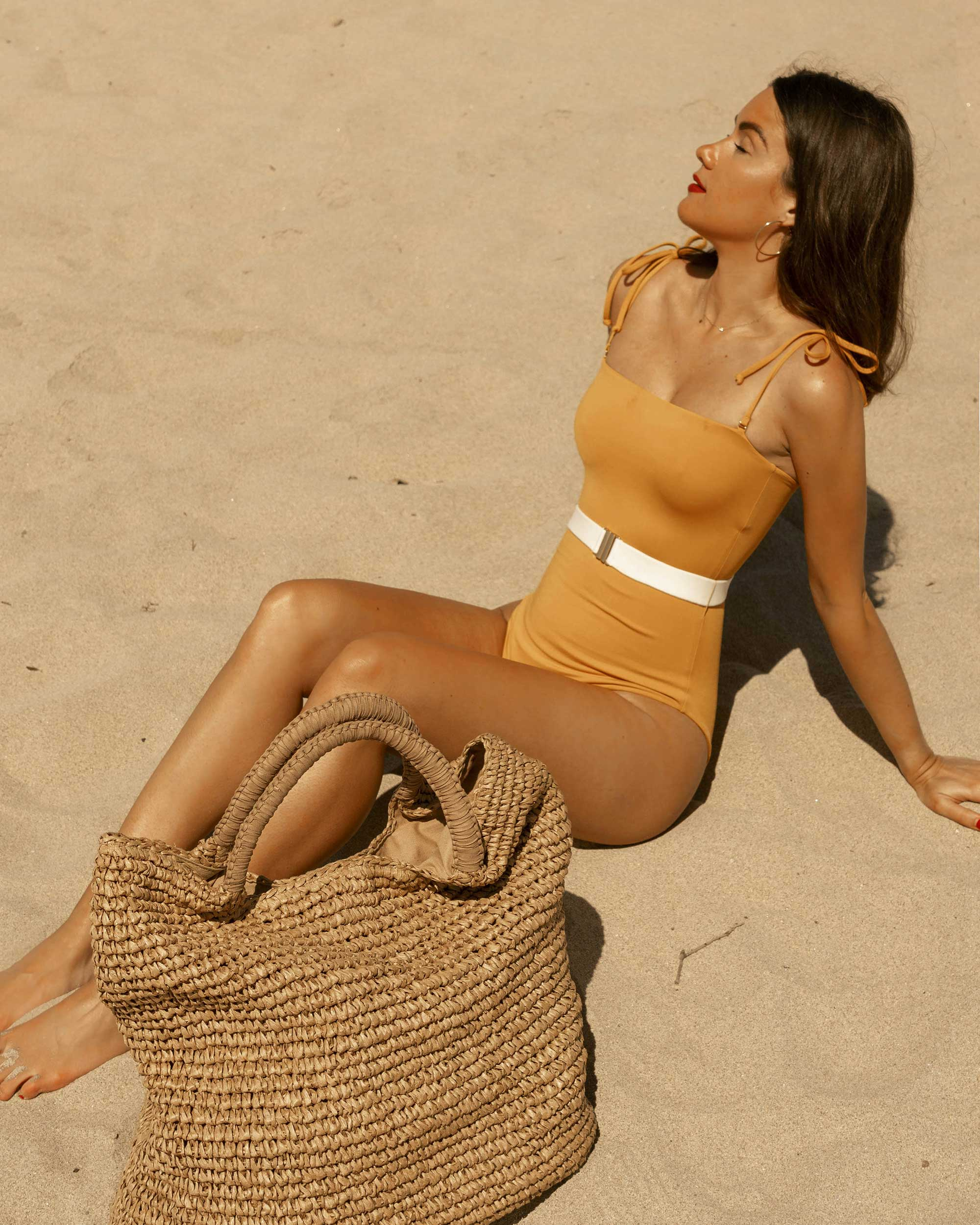 Beach Bound in California - LSpace yellow one piece swimsuit with belt and Fallon & Royce Mel straw oversized straw tote beach bag in Newport Beach, California for the perfect beach outfit