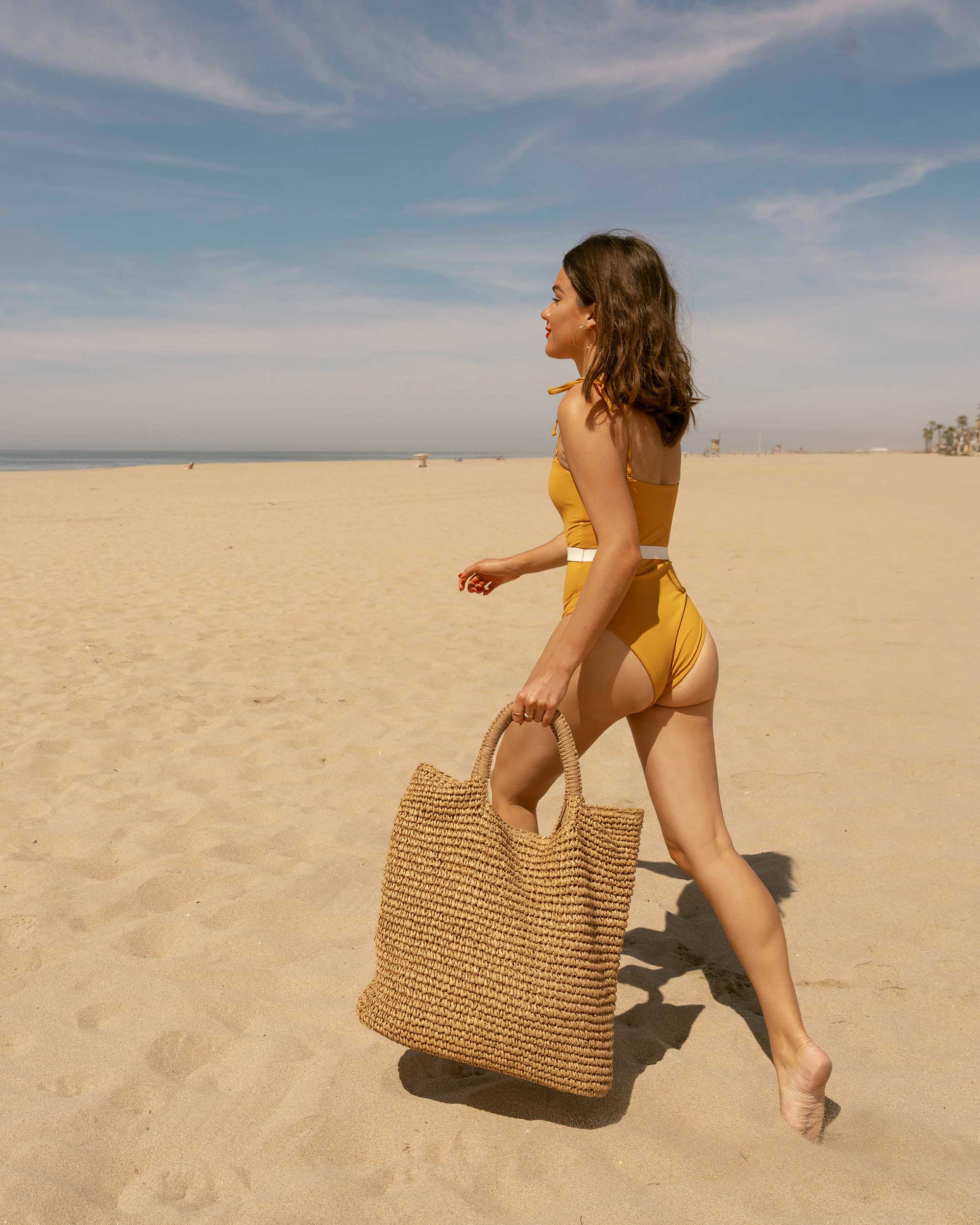 Sarah Butler of Sarah Styles Seattle LSpace Yellow One Piece Swimsuit with belt and Fallon & Royce Mel Straw Oversize Straw Tote Beach Bag in Newport Beach, California for the perfect beach outfit  | @sarahchristine -3.jpg
