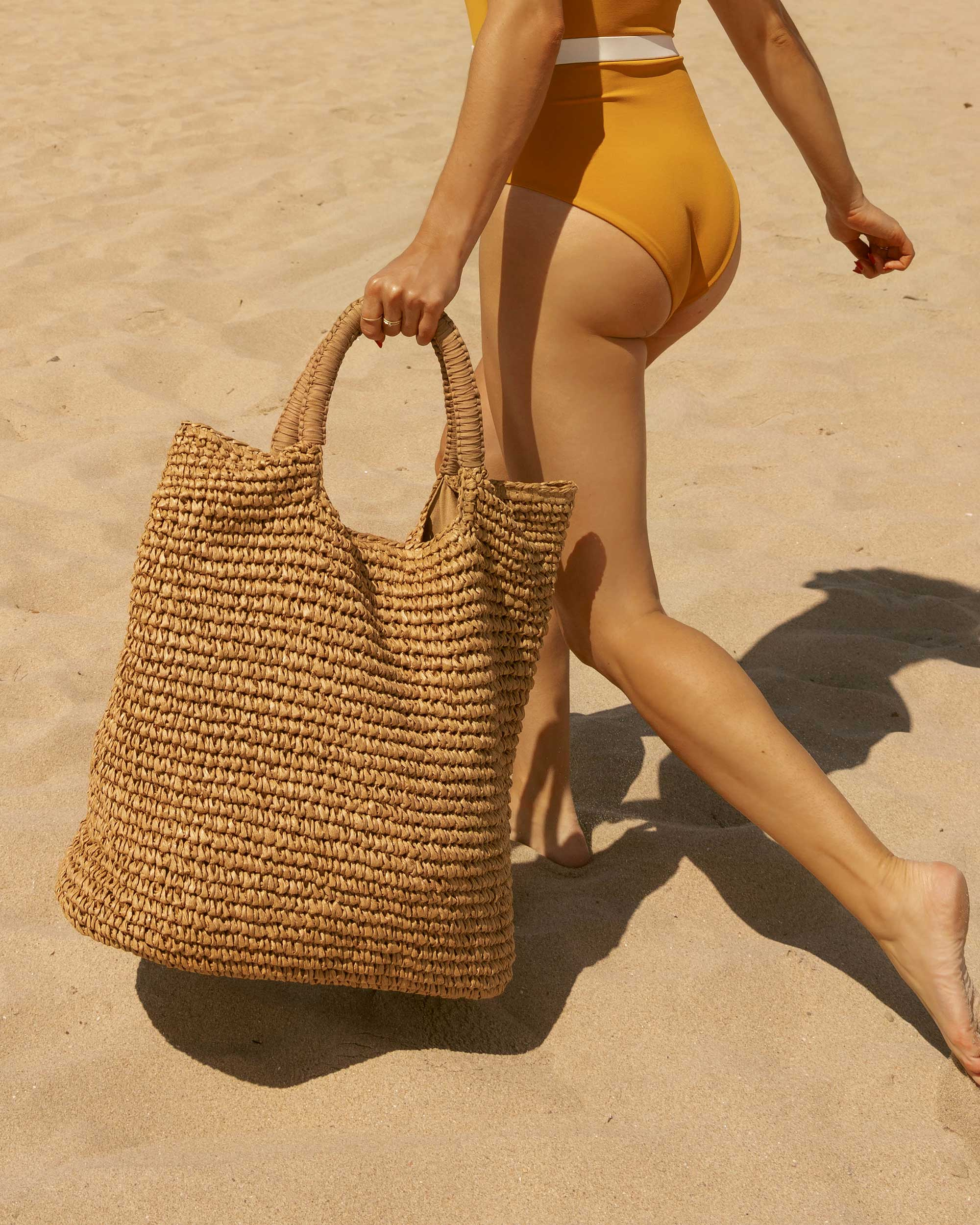 Sarah Butler of Sarah Styles Seattle LSpace Yellow One Piece Swimsuit with belt and Fallon & Royce Mel Straw Oversize Straw Tote Beach Bag in Newport Beach, California for the perfect beach outfit  | @sarahchristine -1.jpg