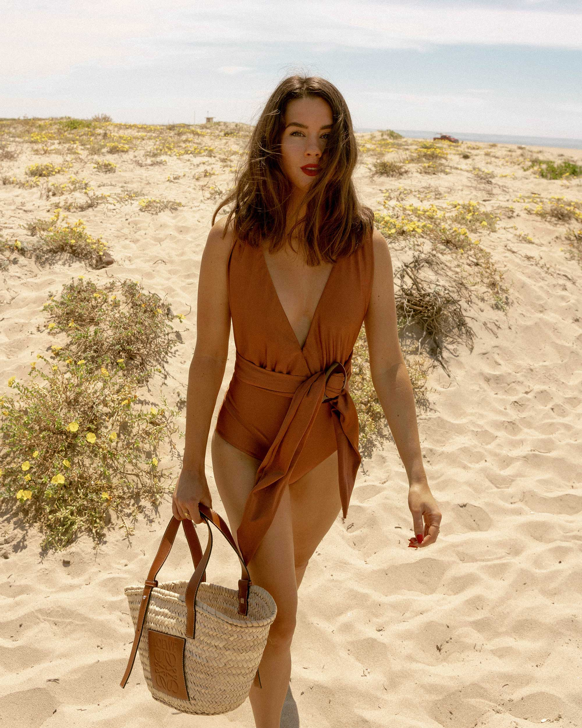 Sarah Butler of Sarah Styles Seattle wears Patbo solid brown belted swimsuit and Loewe Small Raffia Basket Tote Bag for Stylish one-piece swimsuit to wear to the beach | @sarahchristine -5.jpg