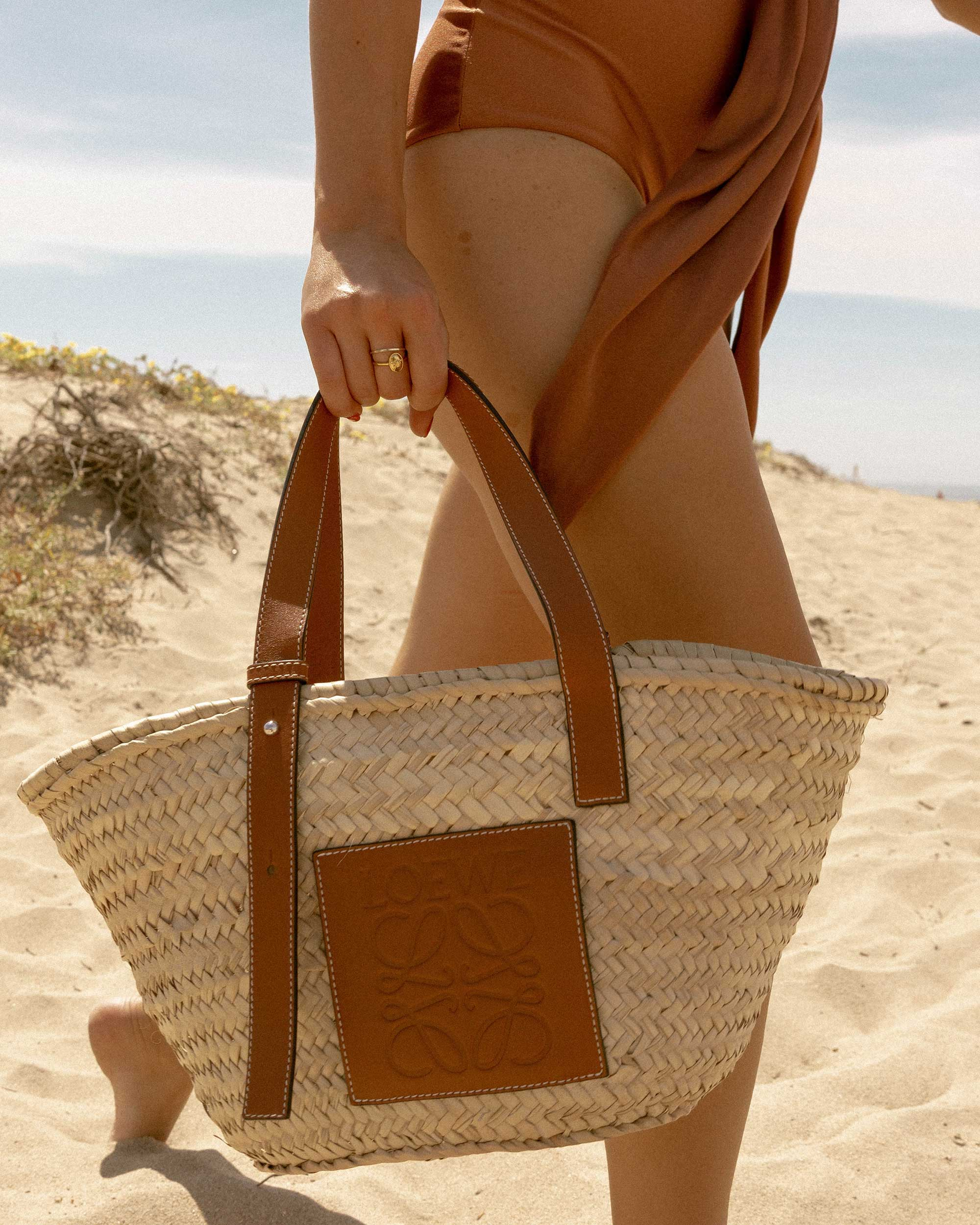 Sarah Butler of Sarah Styles Seattle wears Patbo solid brown belted swimsuit and Loewe Small Raffia Basket Tote Bag for Stylish one-piece swimsuit to wear to the beach | @sarahchristine -4.jpg