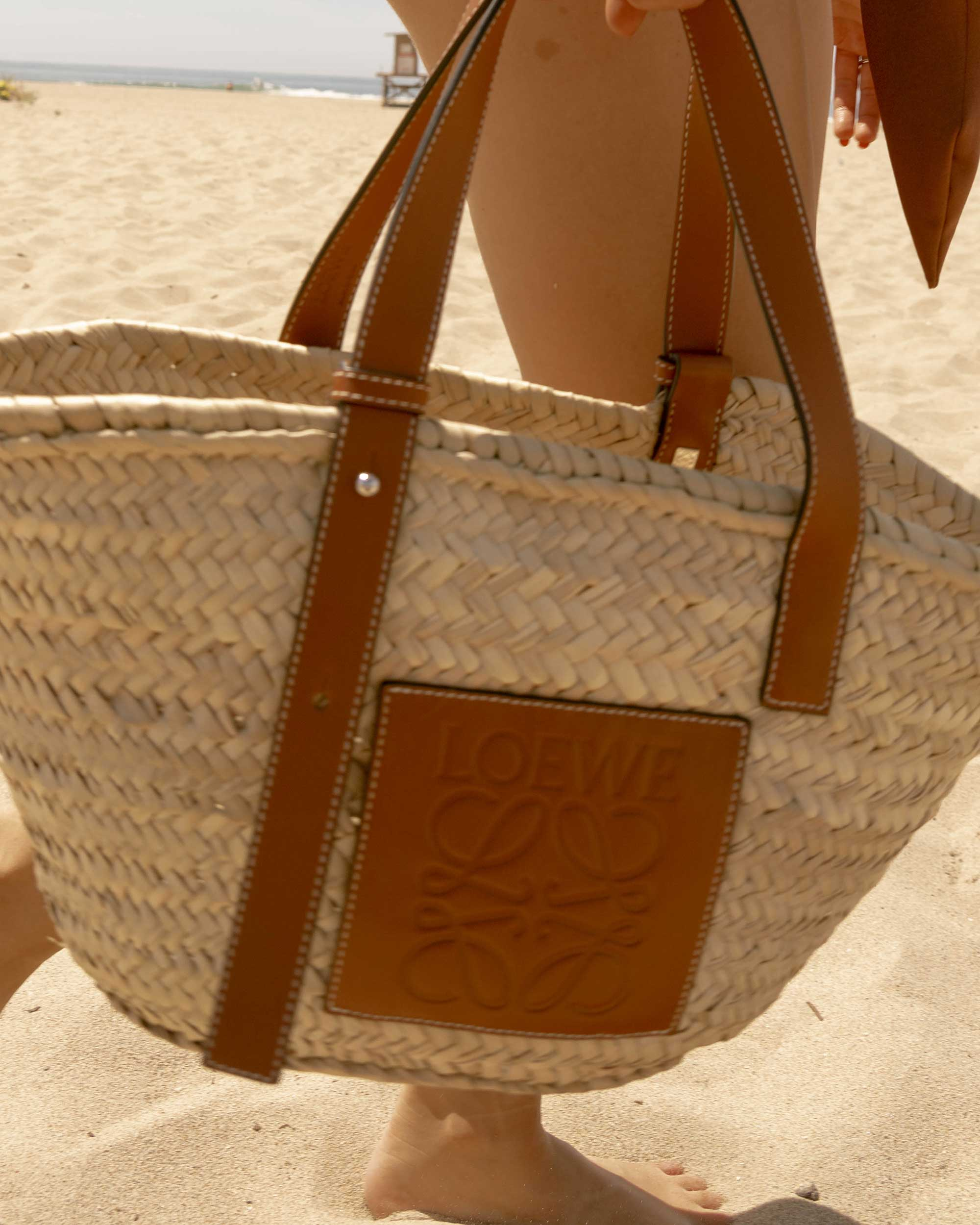 Sarah Butler of Sarah Styles Seattle wears Patbo solid brown belted swimsuit and Loewe Small Raffia Basket Tote Bag for Stylish one-piece swimsuit to wear to the beach | @sarahchristine -10.jpg