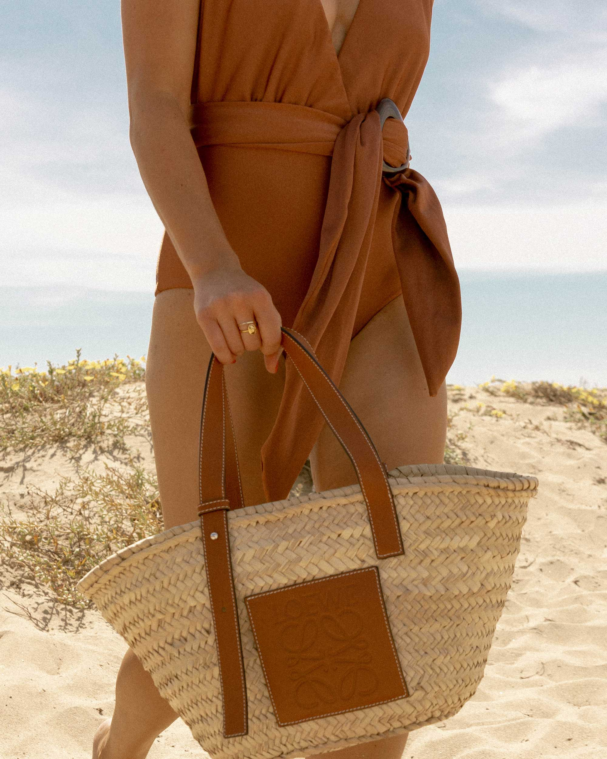 Sarah Butler of Sarah Styles Seattle wears Patbo solid brown belted swimsuit and Loewe Small Raffia Basket Tote Bag for Stylish one-piece swimsuit to wear to the beach | @sarahchristine -11.jpg