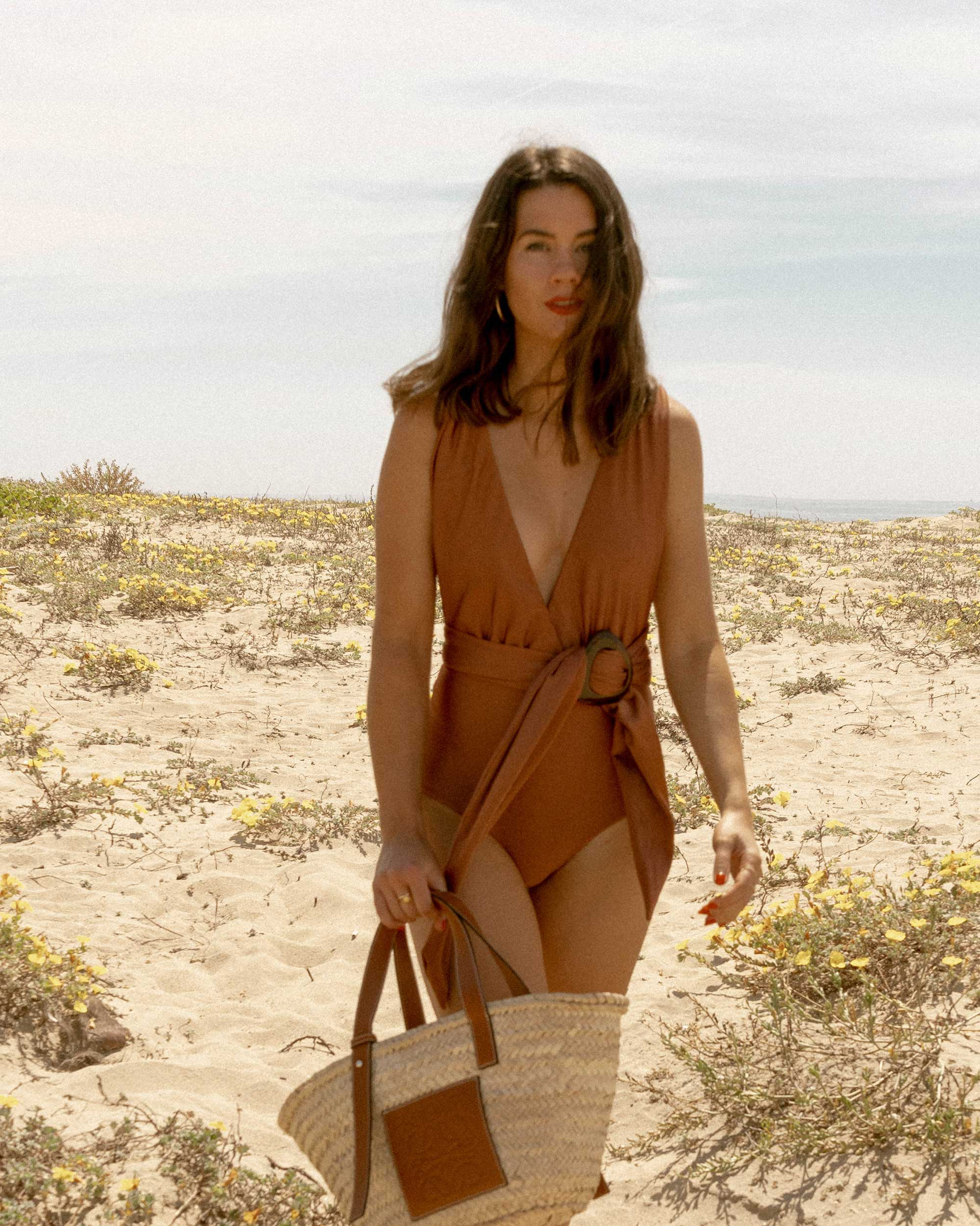 Sarah Butler of Sarah Styles Seattle wears Patbo solid brown belted swimsuit and Loewe Small Raffia Basket Tote Bag for Stylish one-piece swimsuit to wear to the beach | @sarahchristine -8.jpg