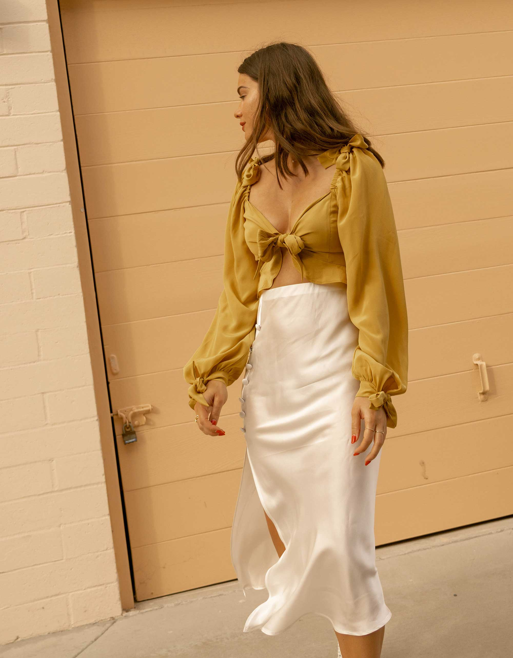 Silk Skirts for Spring - Yellow bell sleeve crop top and side slit silk midi skirt in Newport Beach, California for the perfect spring outfit
