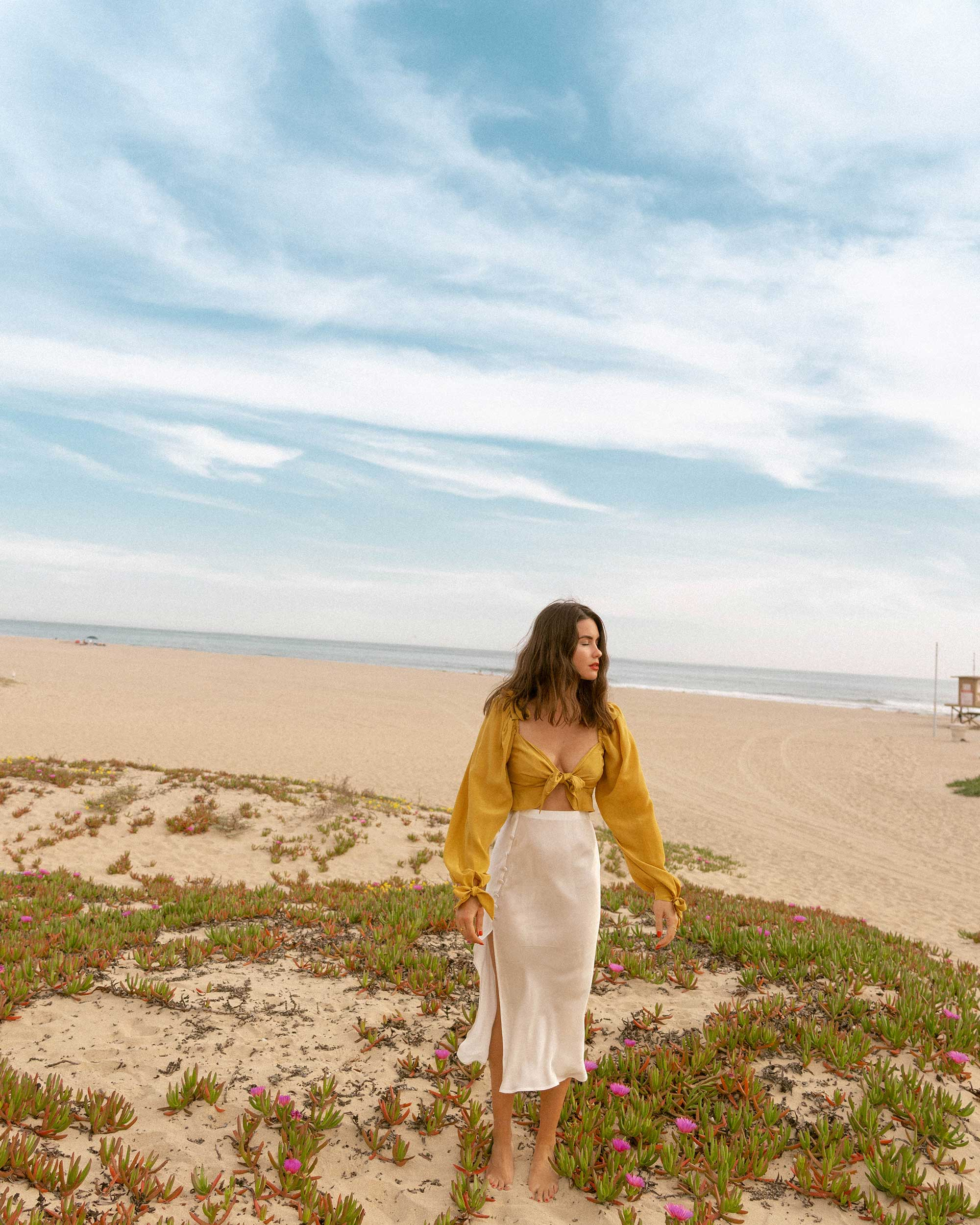 Click to shop outfit + more photos! Sarah Butler of Sarah Styles Seattle wears Yellow bell sleeve crop top and side slit silk midi skirt in Newport Beach, California for the perfect summer outfit | @sarahchristine -1.jpg