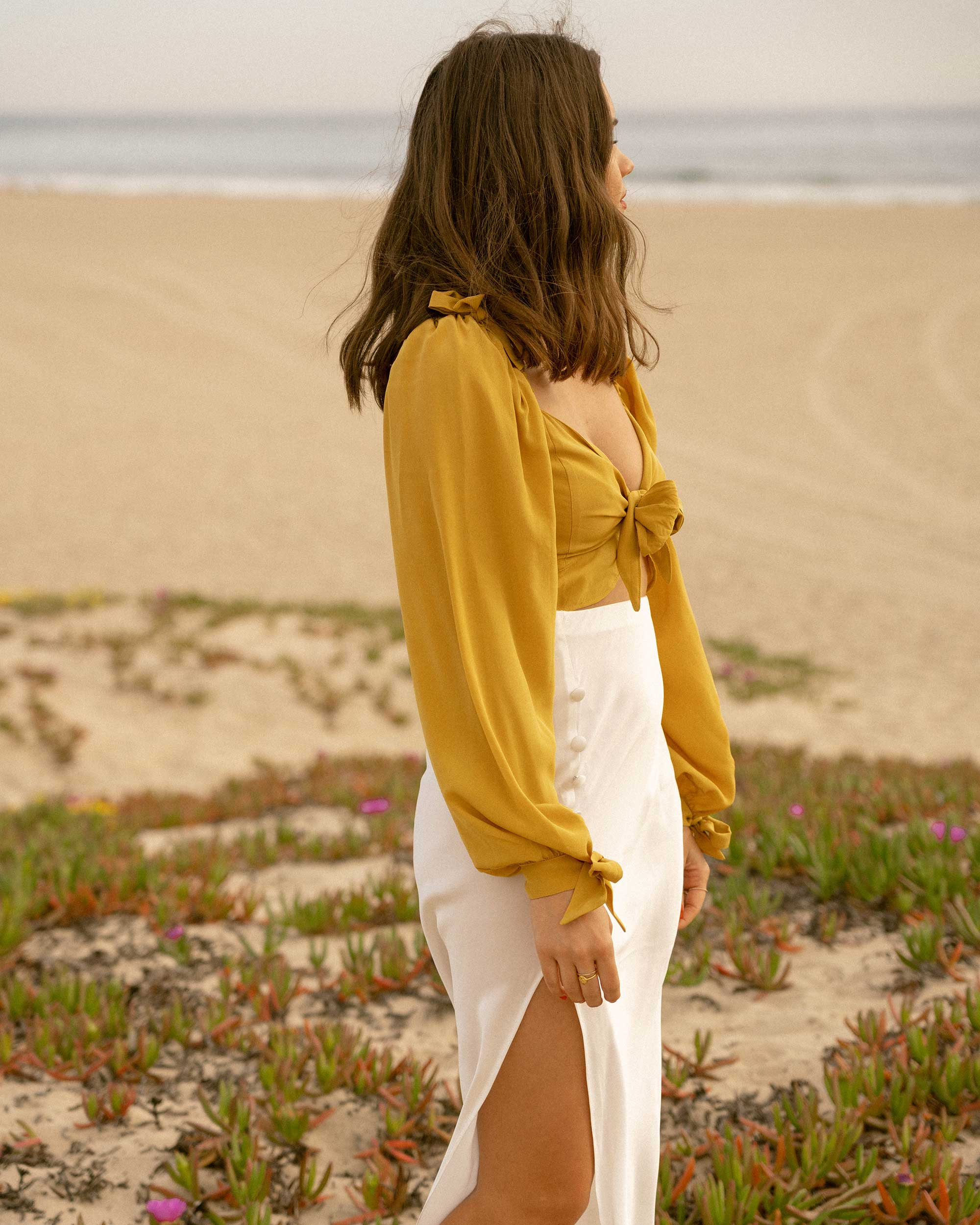Click to shop outfit + more photos! Sarah Butler of Sarah Styles Seattle wears Yellow bell sleeve crop top and side slit silk midi skirt in Newport Beach, California for the perfect summer outfit | @sarahchristine -5.jpg