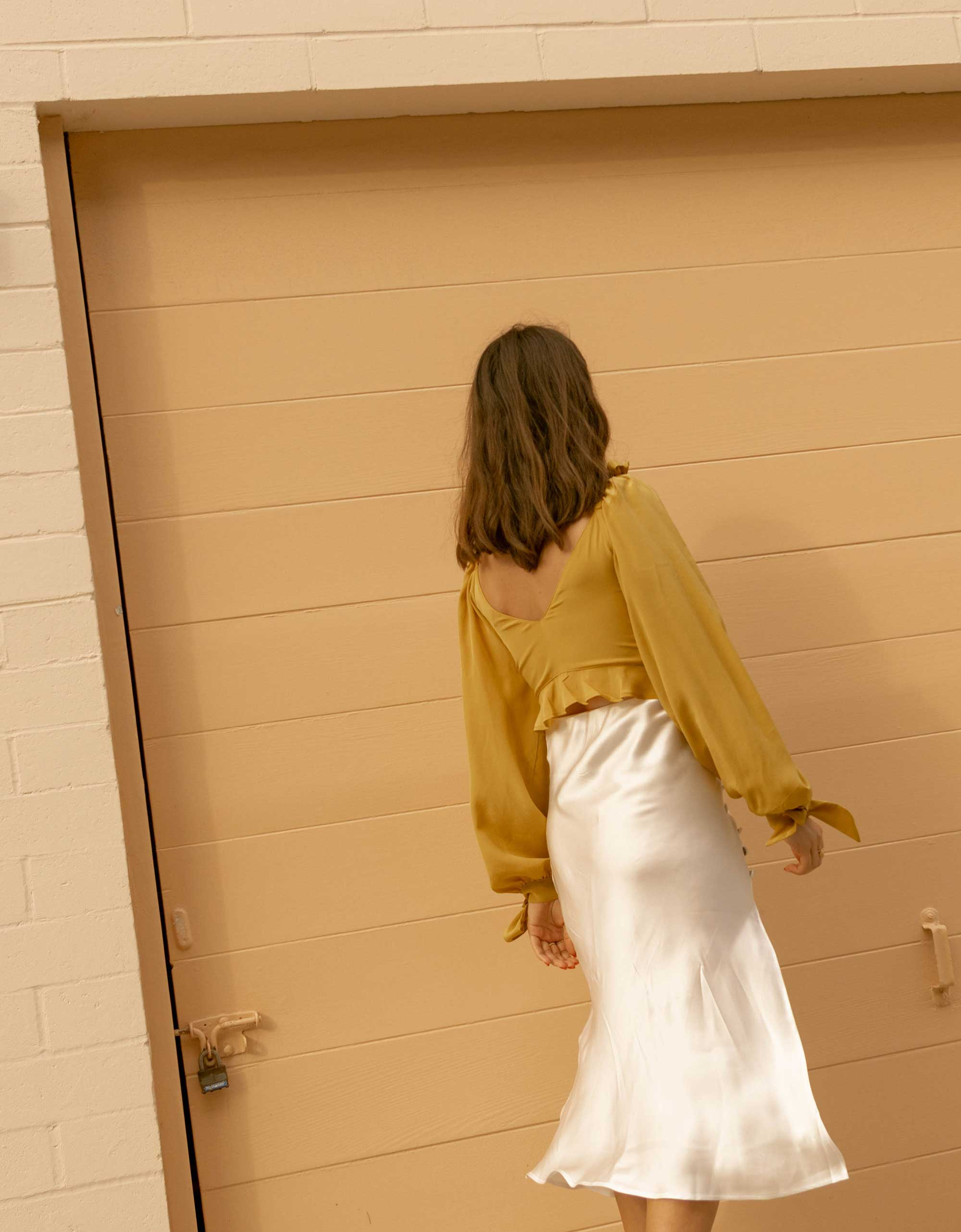 Click to shop outfit + more photos! Sarah Butler of Sarah Styles Seattle wears Yellow bell sleeve crop top and side slit silk midi skirt in Newport Beach, California for the perfect summer outfit | @sarahchristine -8.jpg