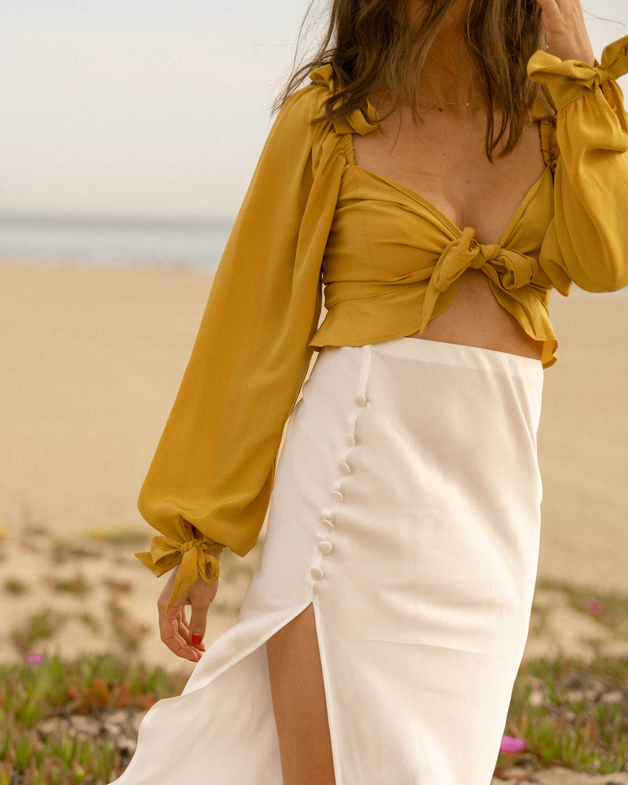 Click to shop outfit + more photos! Sarah Butler of Sarah Styles Seattle wears Yellow bell sleeve crop top and side slit silk midi skirt in Newport Beach, California for the perfect summer outfit | @sarahchristine -4.jpg