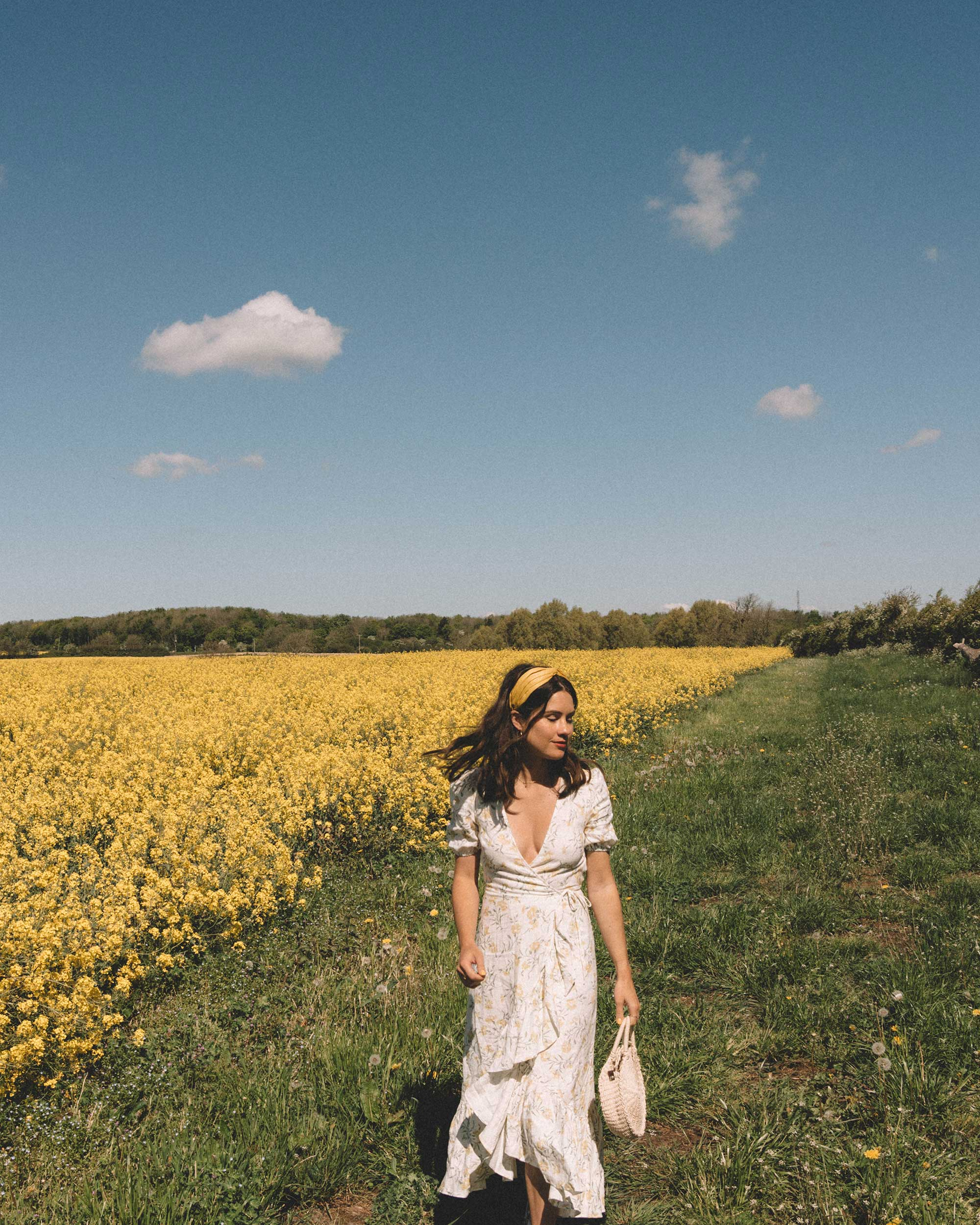 Sarah Butler of Sarah Styles Seattle wears And Other Stories Ruffled Linen Wrap Midi Dress and round woven bag in England Countryside for the perfect floral summer dress | @sarahchristine 1.jpg