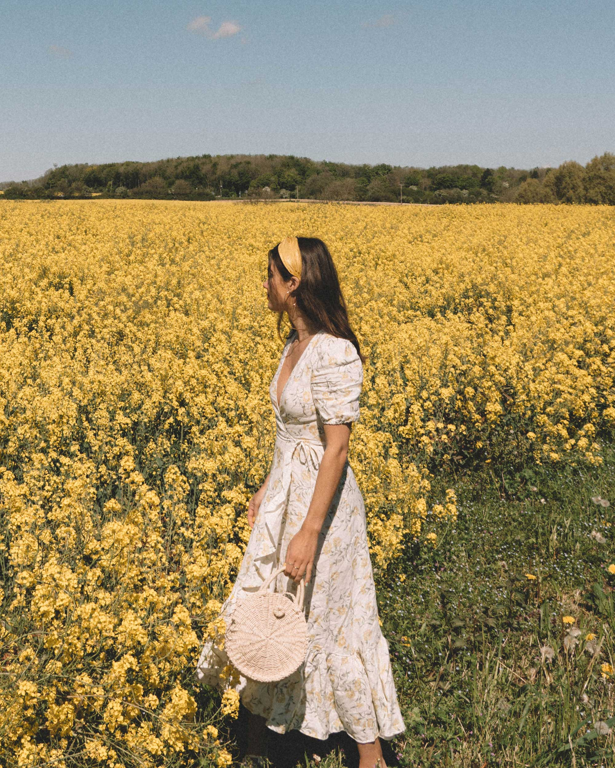 Sarah Butler of Sarah Styles Seattle wears And Other Stories Ruffled Linen Wrap Midi Dress and round woven bag in England Countryside for the perfect floral summer dress | @sarahchristine 5.jpg