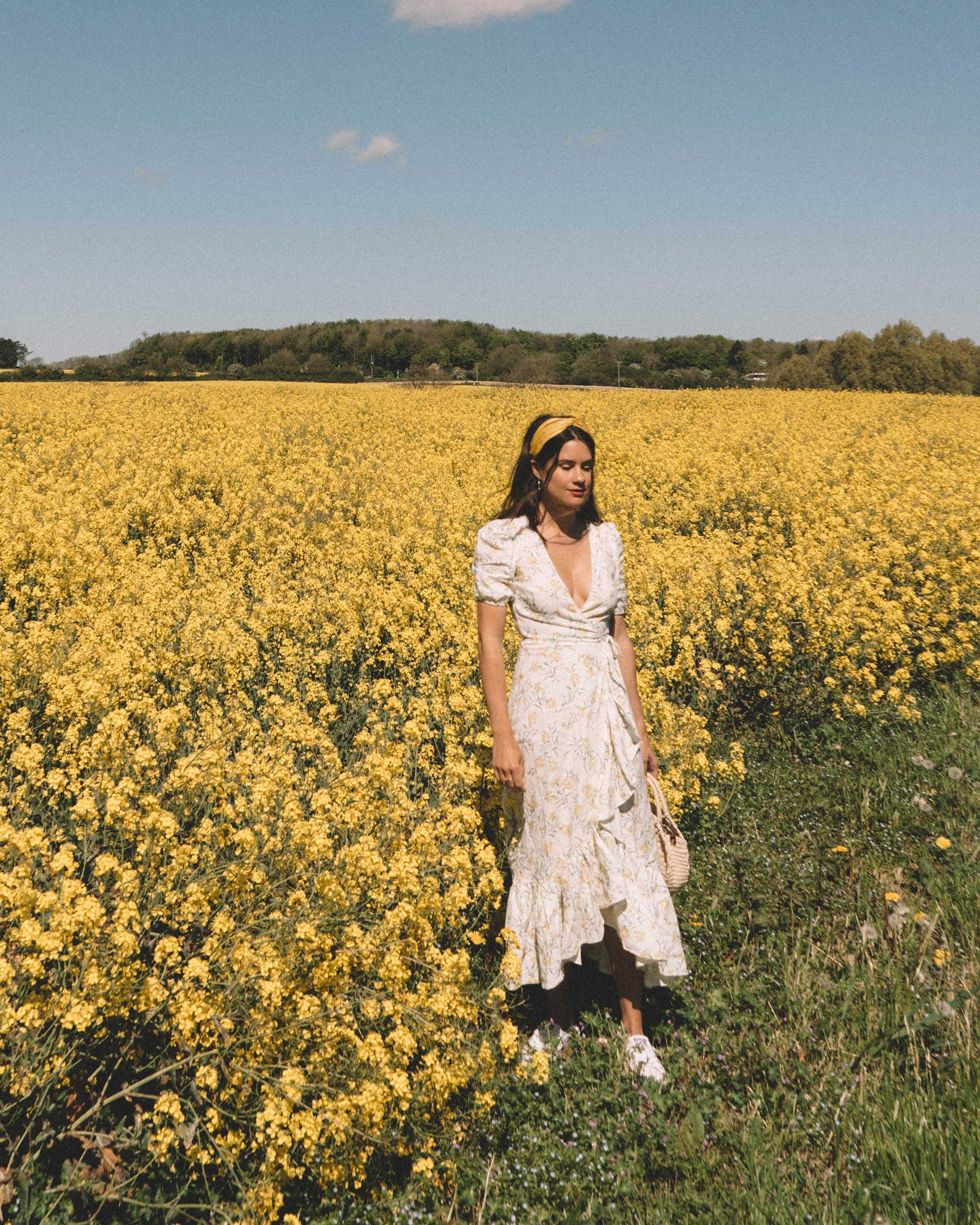 Sarah Butler of Sarah Styles Seattle wears And Other Stories Ruffled Linen Wrap Midi Dress and round woven bag in England Countryside for the perfect floral summer dress | @sarahchristine 17.jpg