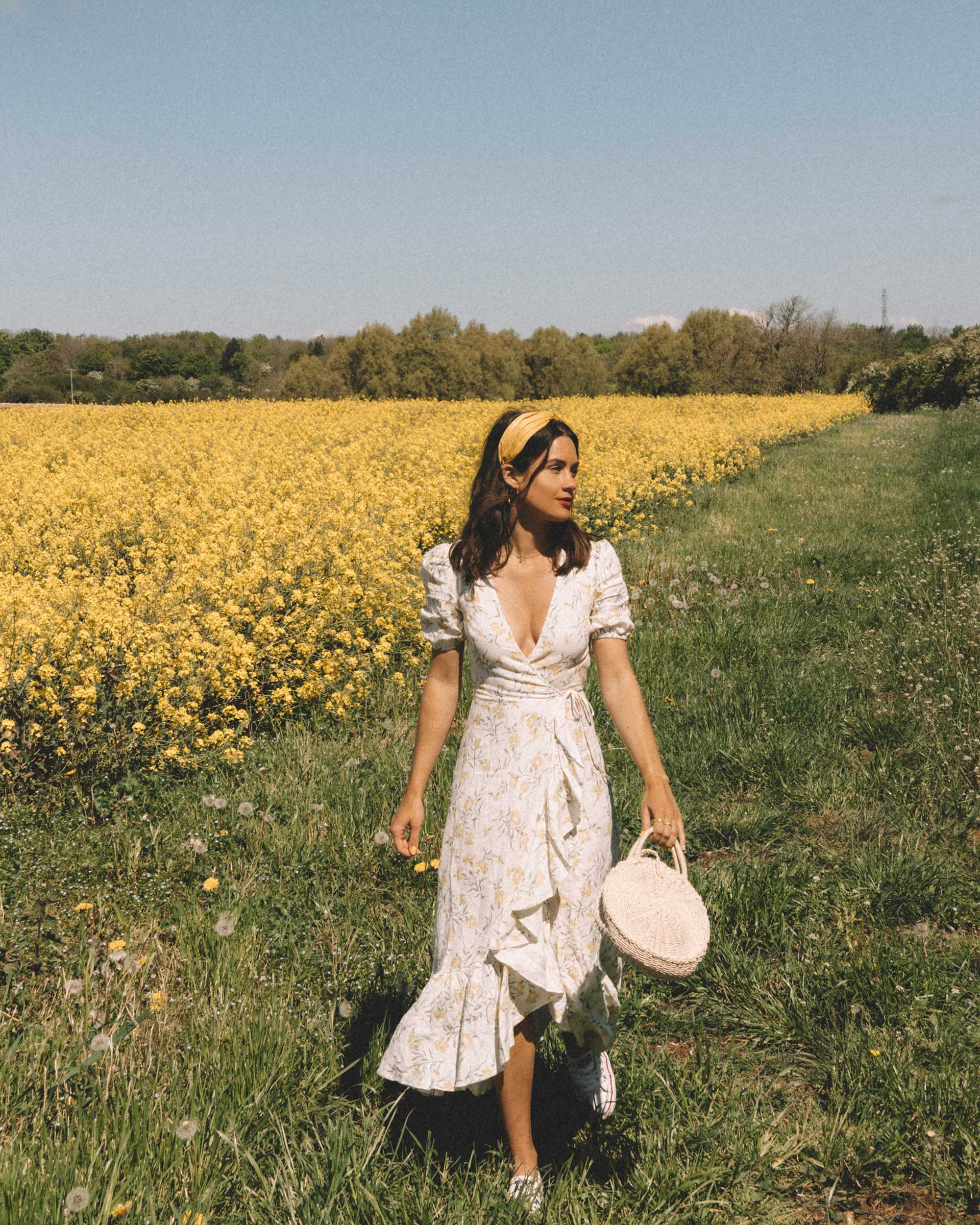 Sarah Butler of Sarah Styles Seattle wears And Other Stories Ruffled Linen Wrap Midi Dress and round woven bag in England Countryside for the perfect floral summer dress | @sarahchristine 18.jpg