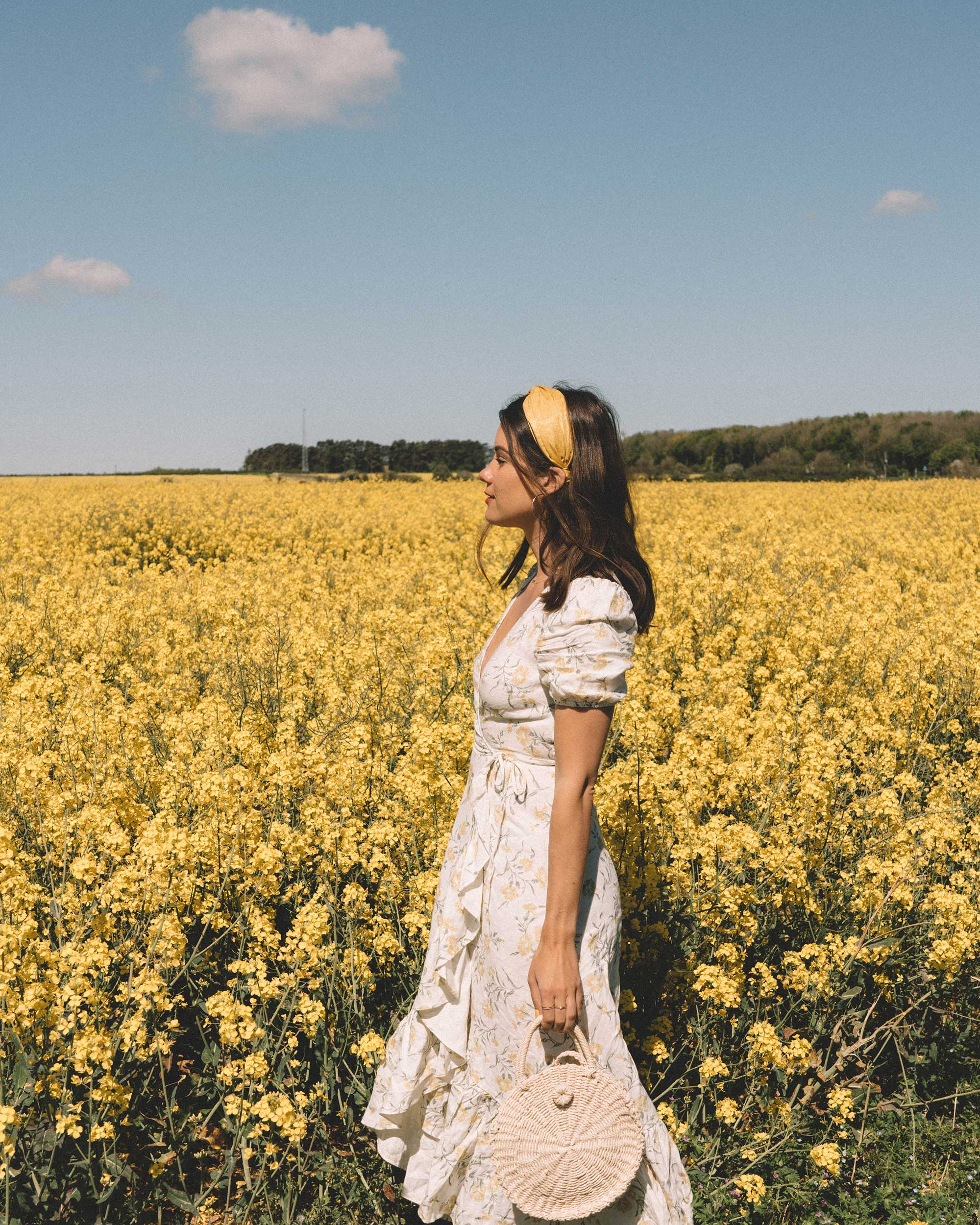 Sarah Butler of Sarah Styles Seattle wears And Other Stories Ruffled Linen Wrap Midi Dress and round woven bag in England Countryside for the perfect floral summer dress | @sarahchristine 2.jpg