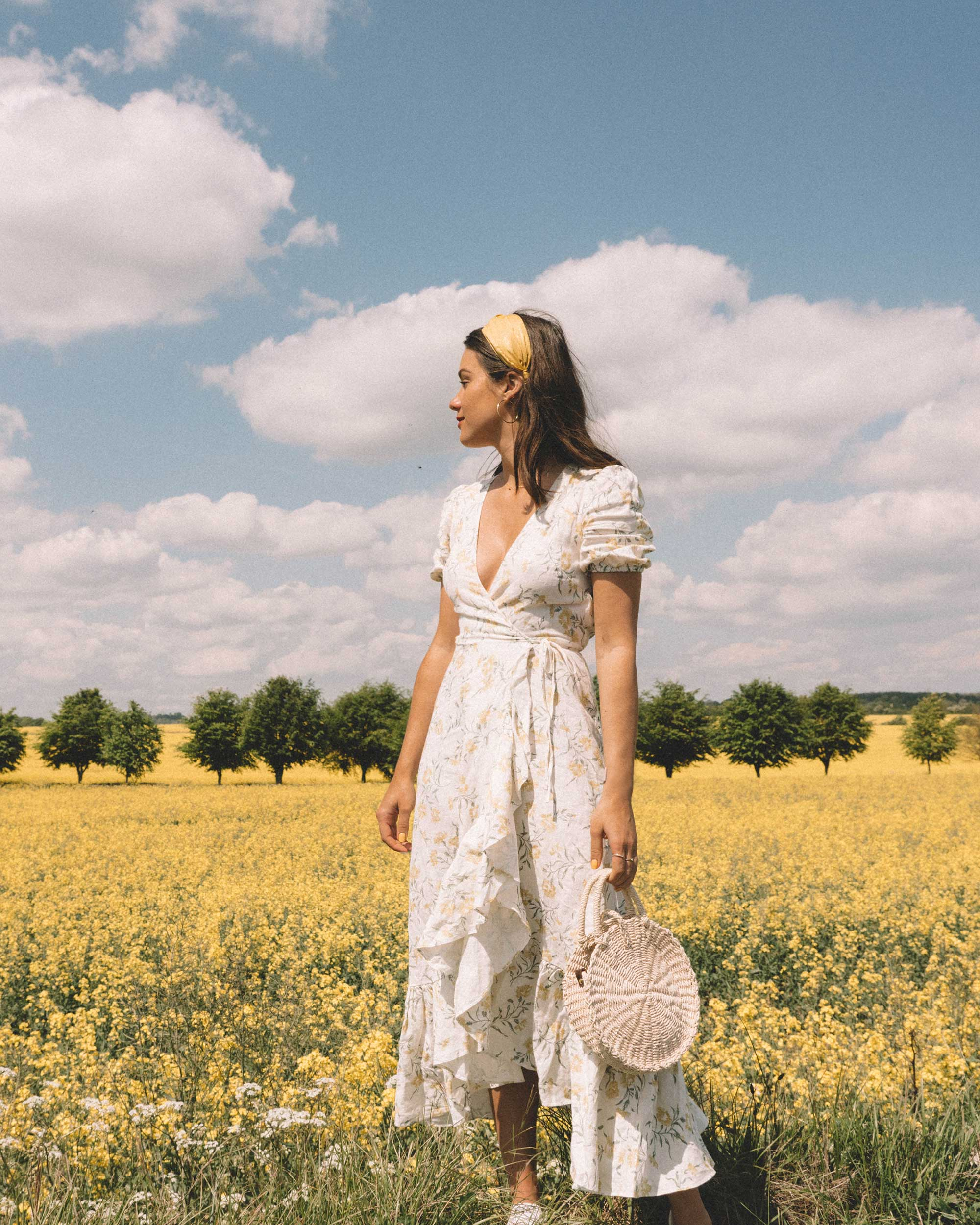 Summer in the English Countryside - Exploring the beauty of the English Countryside in And Other Stories ruffled linen wrap midi dress and round woven bag.