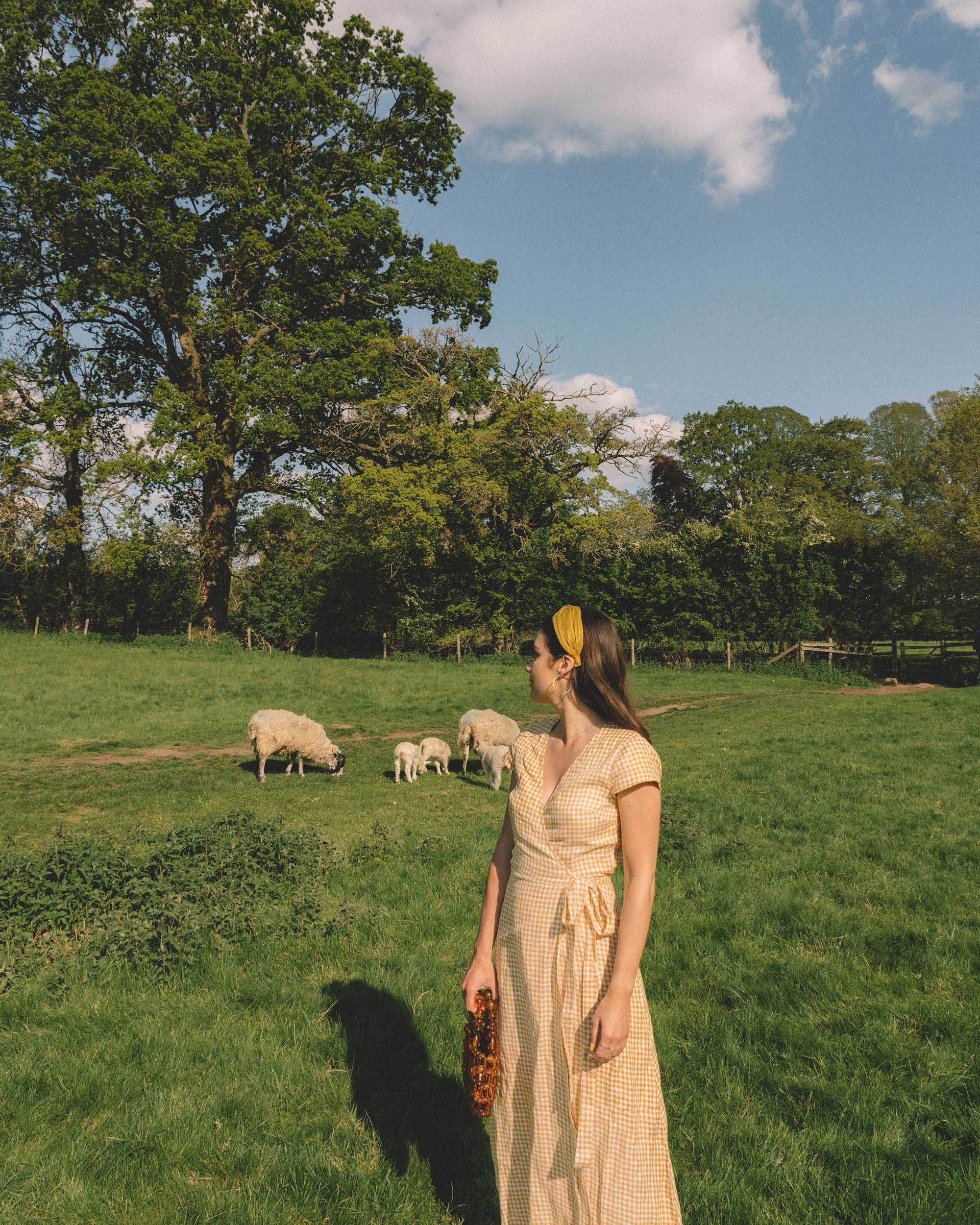 Sarah Butler of Sarah Styles Seattle explores the English Countryside Cotswolds wearing Gingham Linen Midi Wrap Dress | @sarahchristine -3.jpg