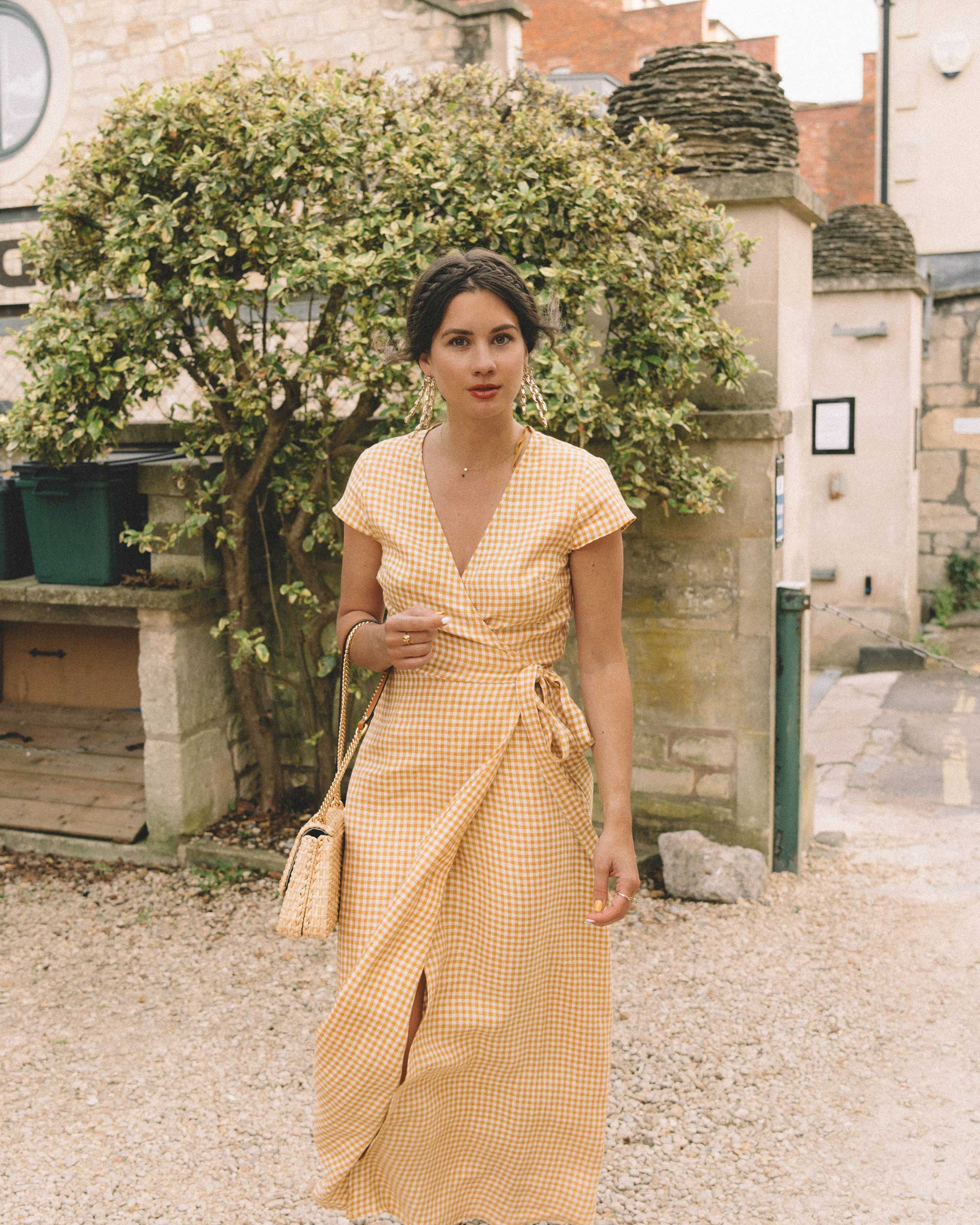Gingham in England - Exploring the English Countryside Cotswolds wearing a gingham linen midi wrap dress from & Other Stories.