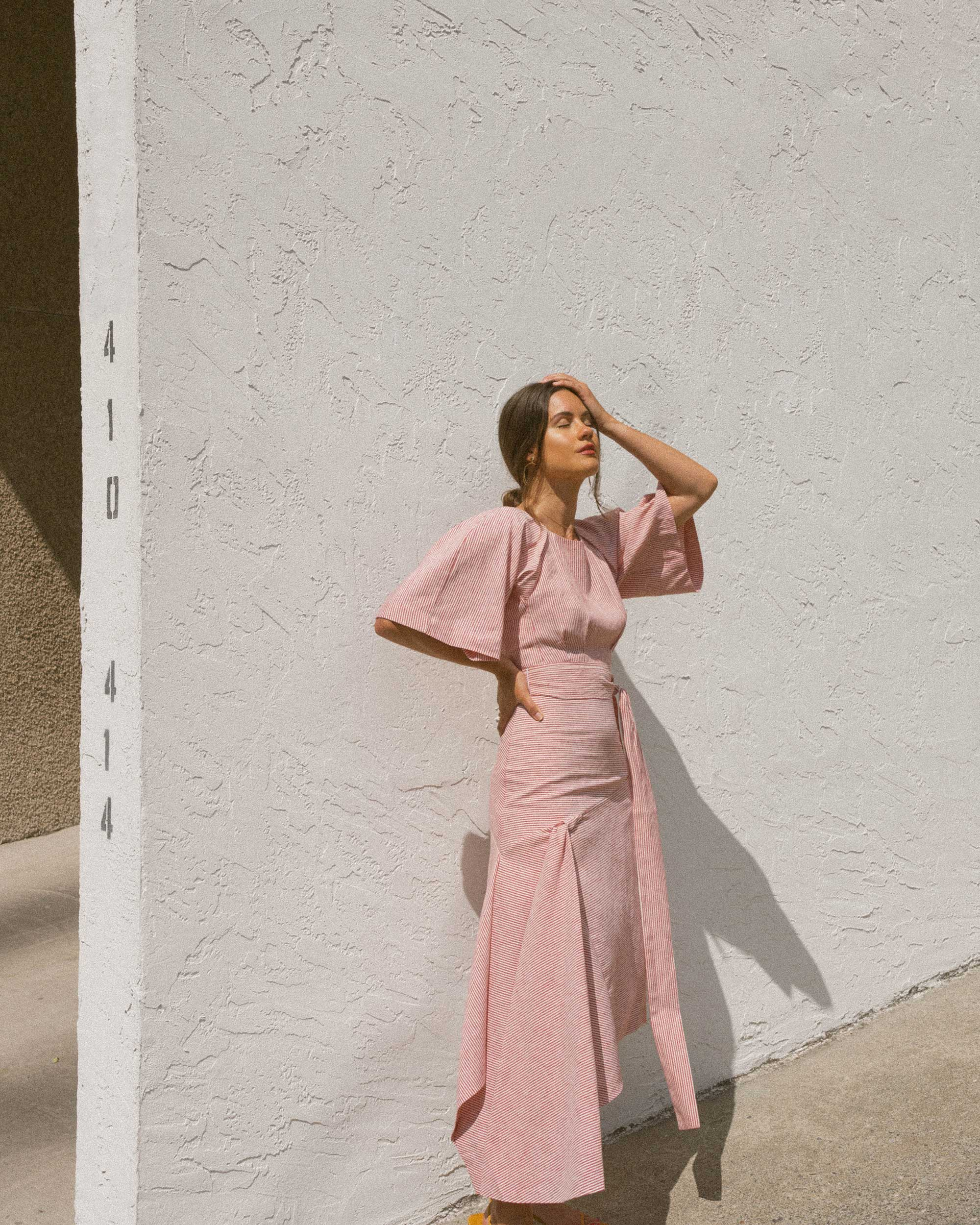 Sarah Butler of Sarah Styles wears BcbgMaxAzria Pinstripe Asymmetric Skirt and Pinstripe Cutout Back Cropped Top in Seattle   @sarahchristine -6.jpg