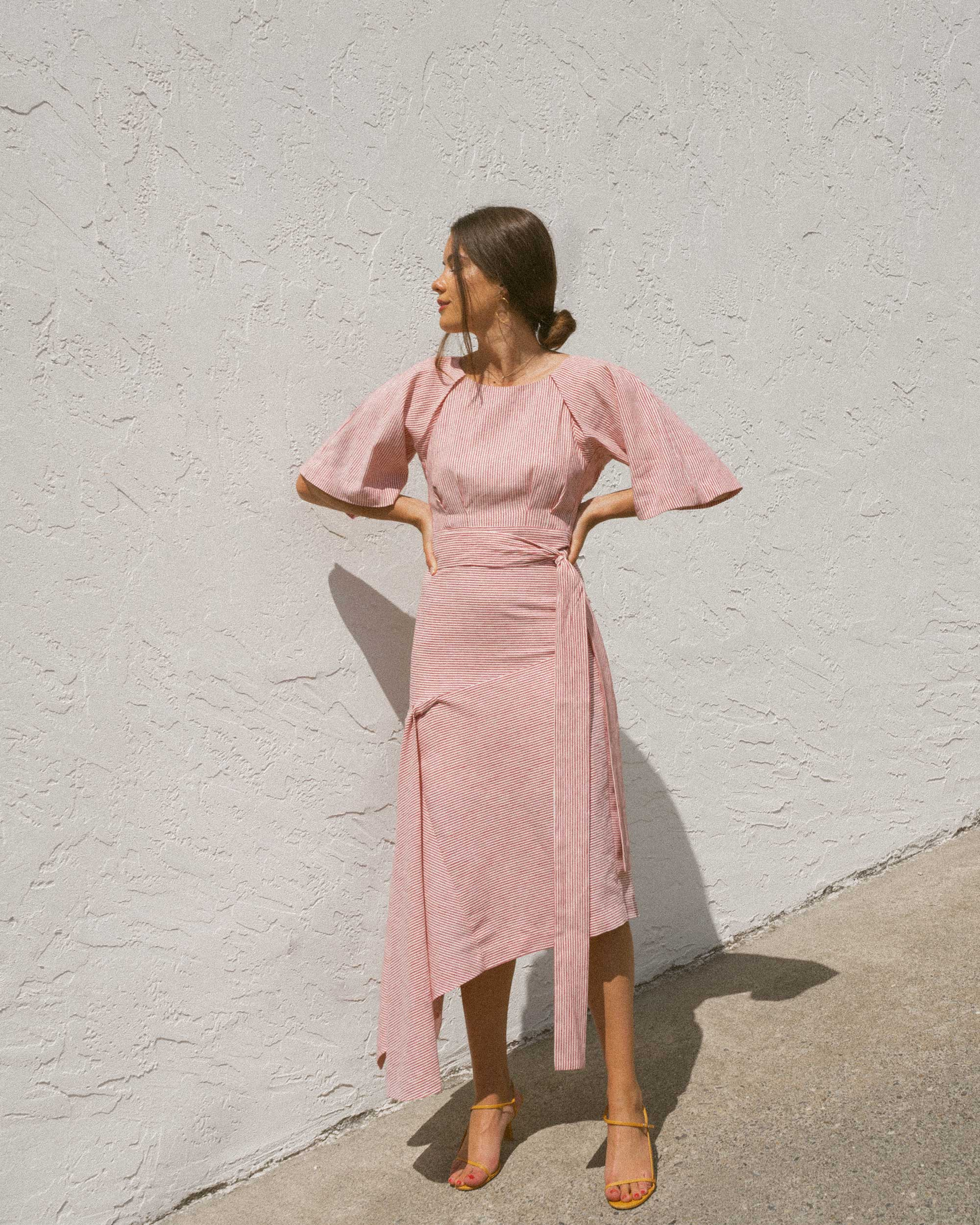Sarah Butler of Sarah Styles wears BcbgMaxAzria Pinstripe Asymmetric Skirt and Pinstripe Cutout Back Cropped Top in Seattle   @sarahchristine -4.jpg