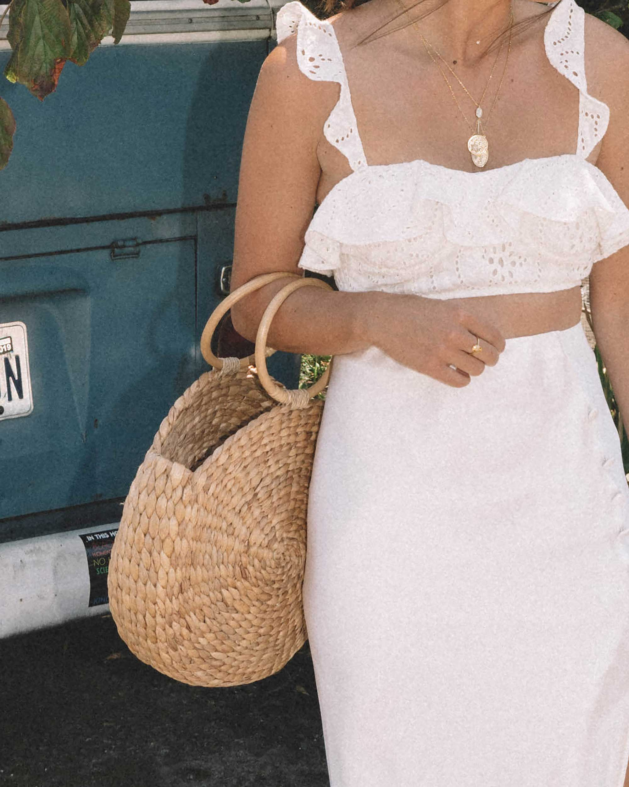 Sarah Butler of Sarah Styles wearing white summer outfit featuring Satin Bias Cut Skirt and Lovers + Friends Charlotte White Eyelet Bralette in Seattle | @sarahchristine --1.jpg