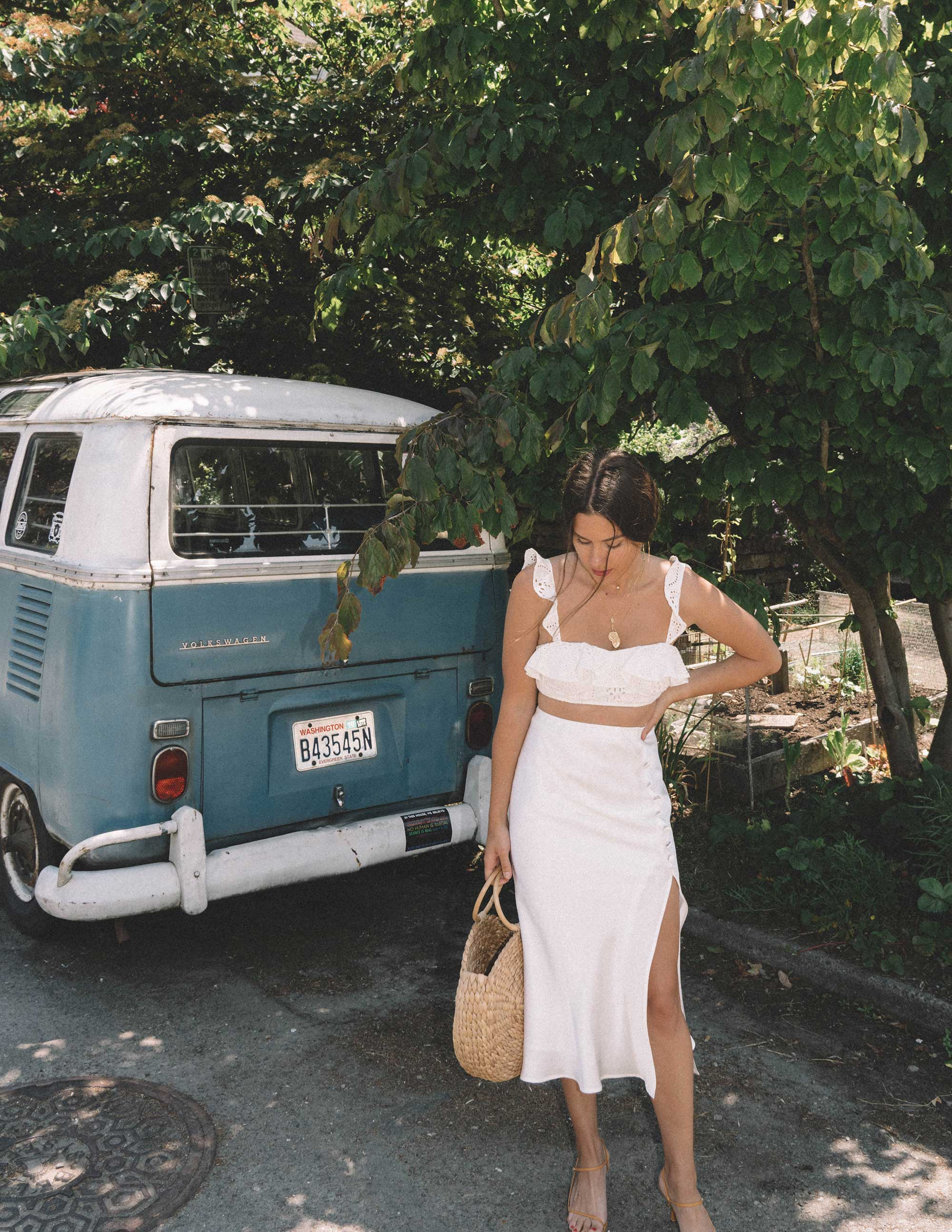 Sarah Butler of Sarah Styles wearing white summer outfit featuring Satin Bias Cut Skirt and Lovers + Friends Charlotte White Eyelet Bralette in Seattle | @sarahchristine -8.jpg