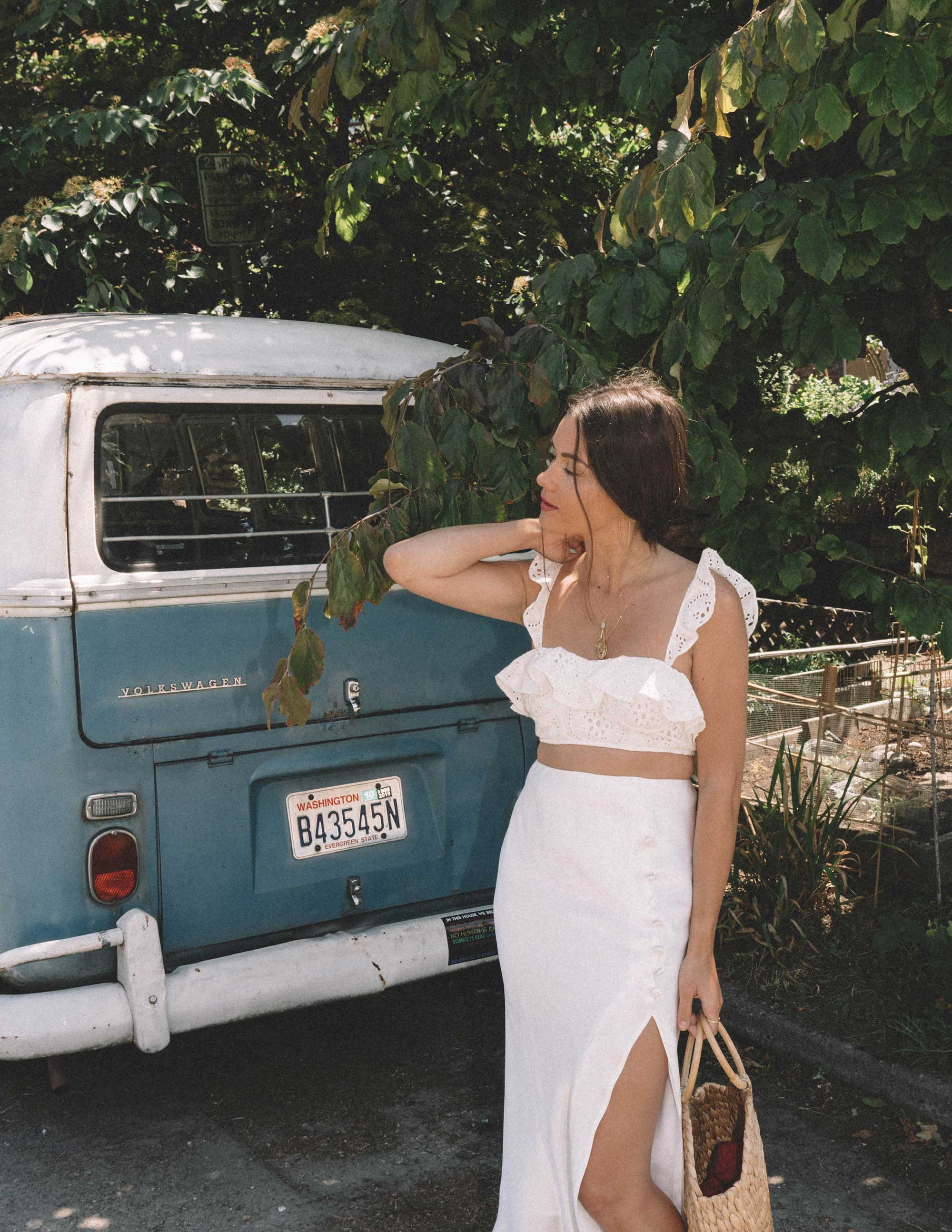 Sarah Butler of Sarah Styles wearing white summer outfit featuring Satin Bias Cut Skirt and Lovers + Friends Charlotte White Eyelet Bralette in Seattle | @sarahchristine -3.jpg