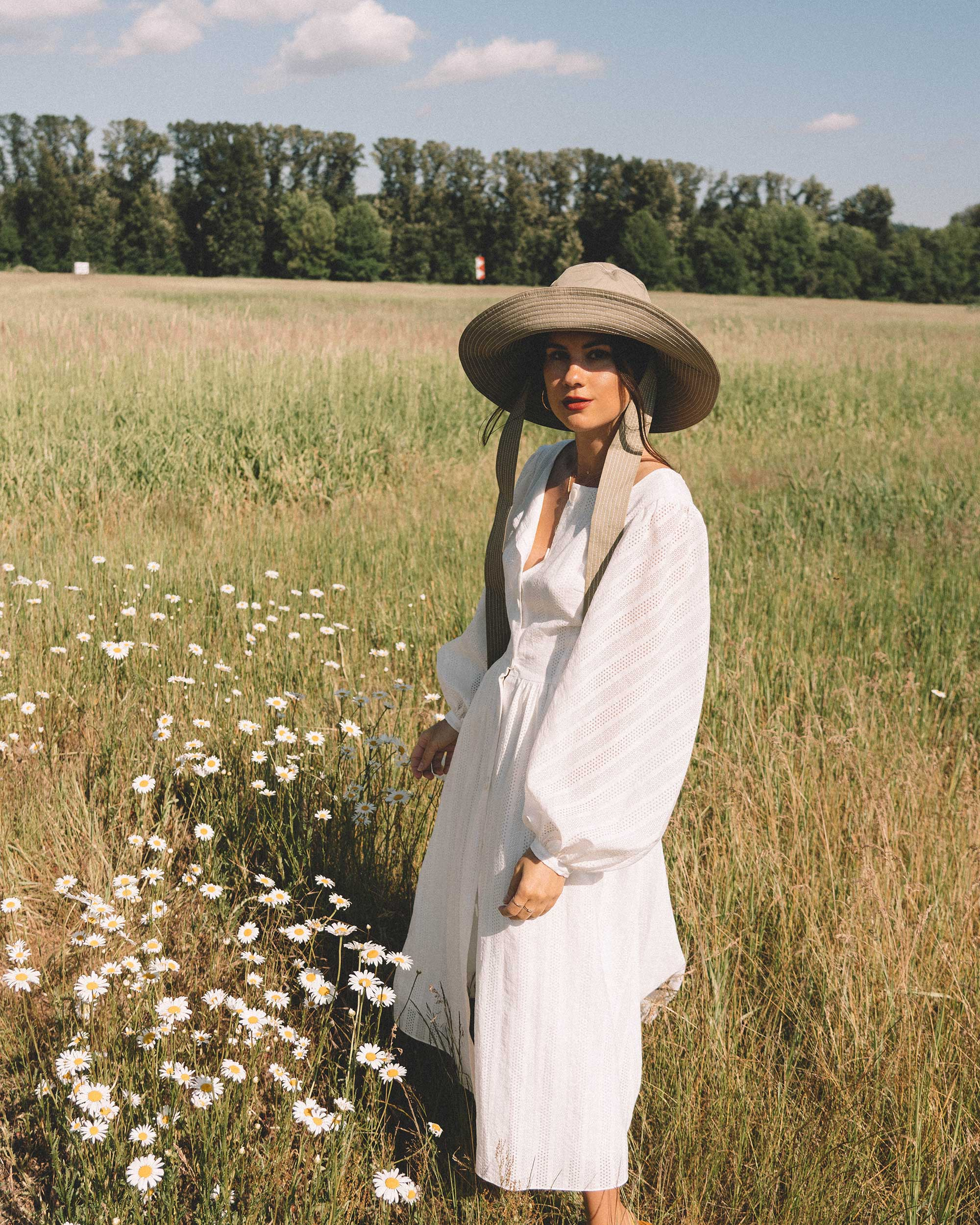 Sarah Butler of Sarah Styles wearing Poustovit White Maxi Dress with billowy sleeves and Ganni wide brim hat in Seattle   @sarahchristine -4.jpg