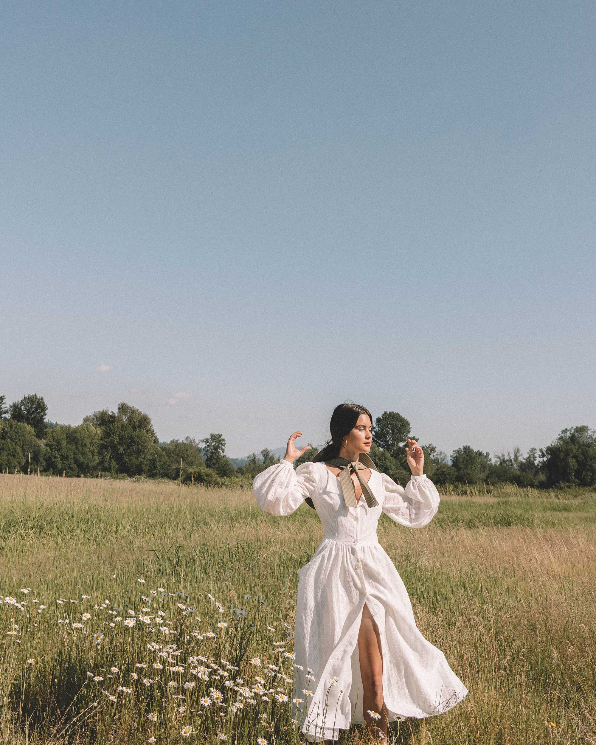 Sarah Butler of Sarah Styles wearing Poustovit White Maxi Dress with billowy sleeves and Ganni wide brim hat in Seattle   @sarahchristine -7.jpg