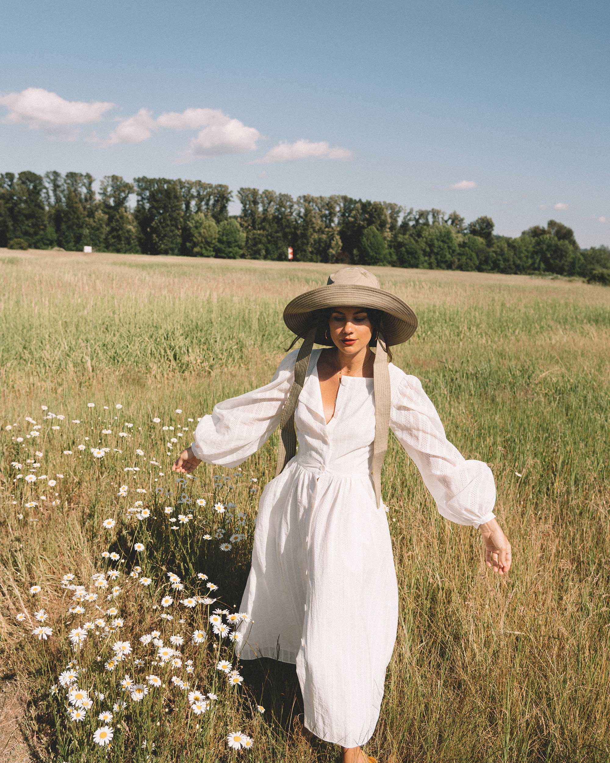 Sarah Butler of Sarah Styles wearing Poustovit White Maxi Dress with billowy sleeves and Ganni wide brim hat in Seattle | @sarahchristine -3.jpg