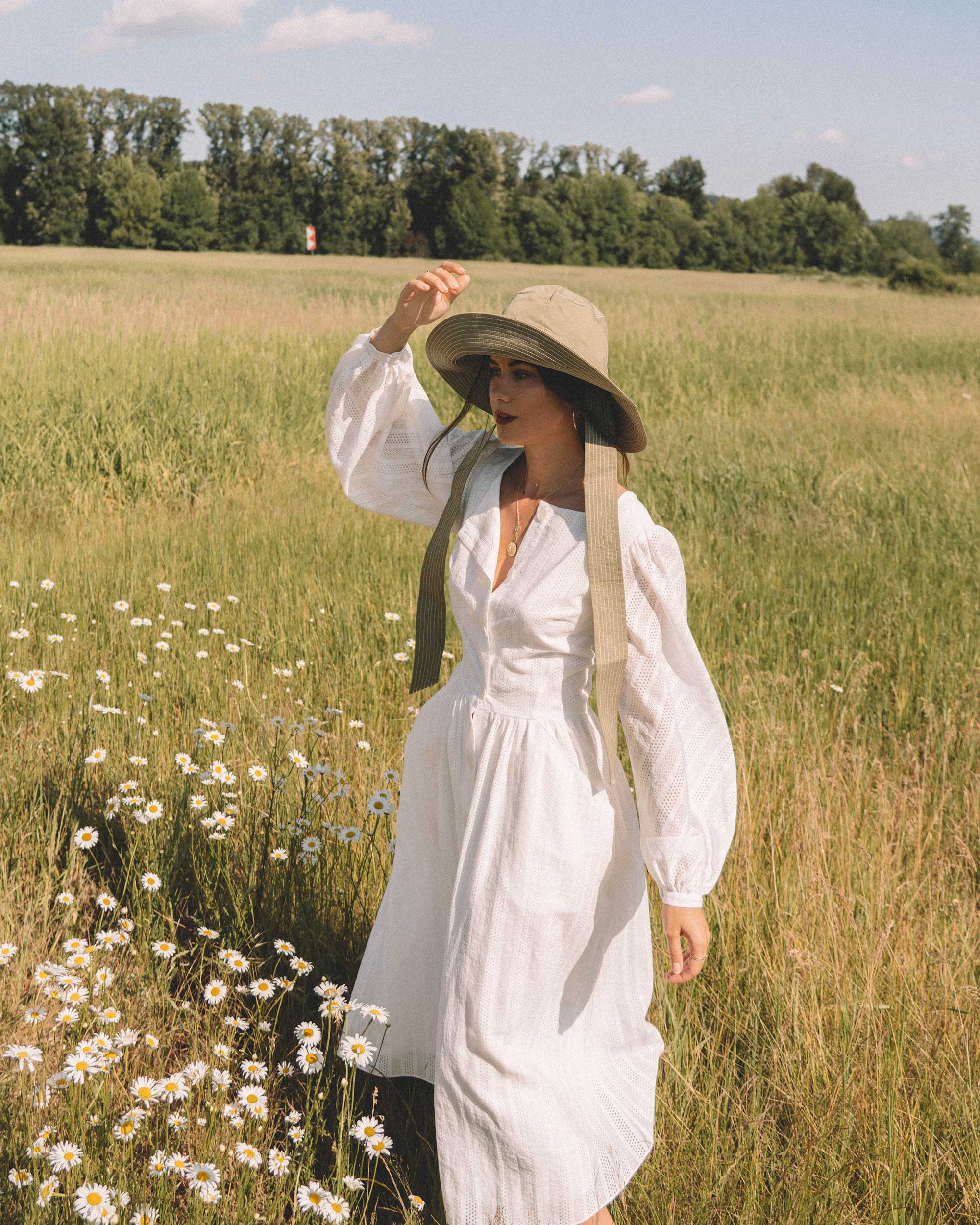 Sarah Butler of Sarah Styles wearing Poustovit White Maxi Dress with billowy sleeves and Ganni wide brim hat in Seattle | @sarahchristine -6.jpg