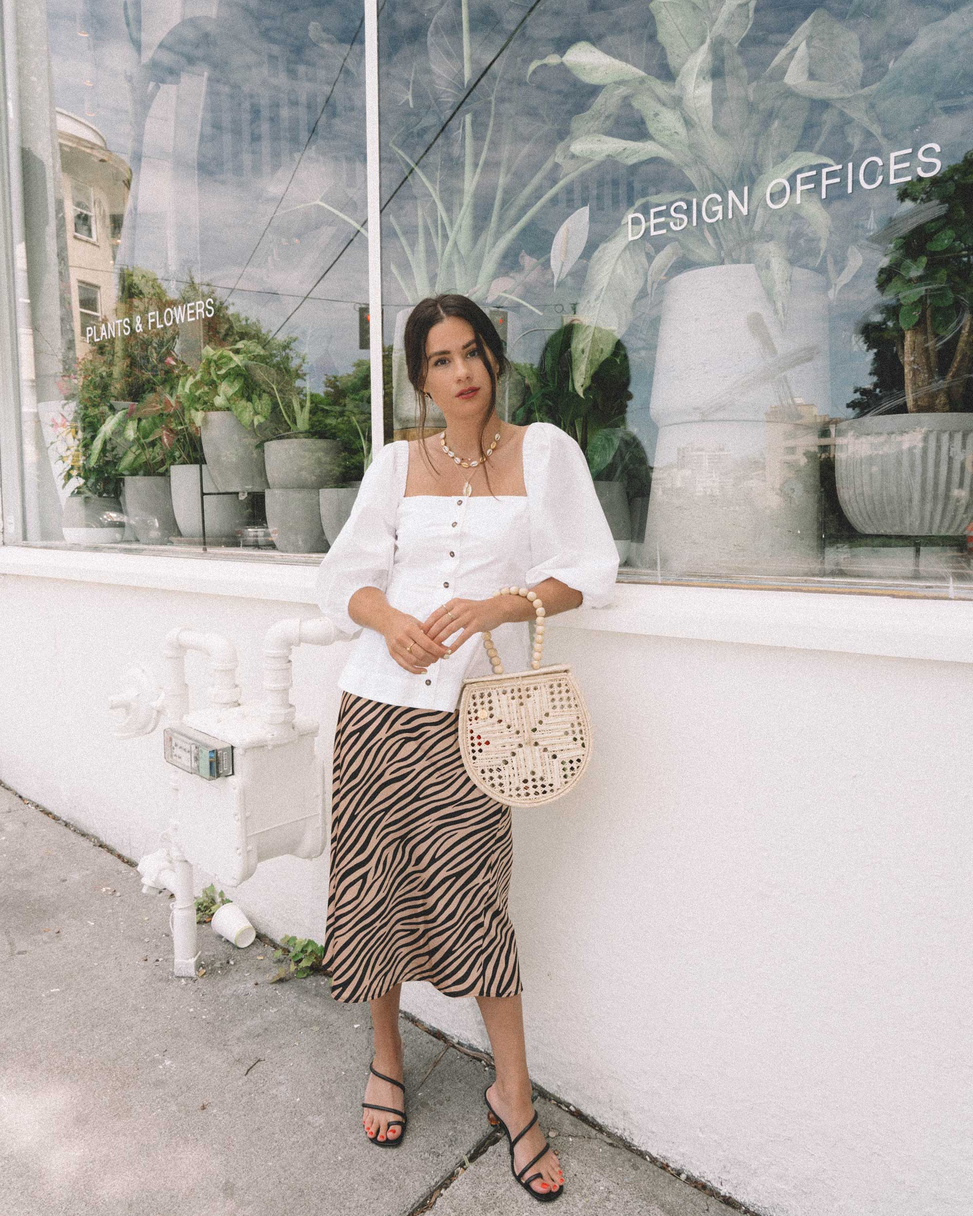 Ganni Girl in Seattle - Seattle summer days in Ganni puff sleeve top and tiger Print Midi Skirt