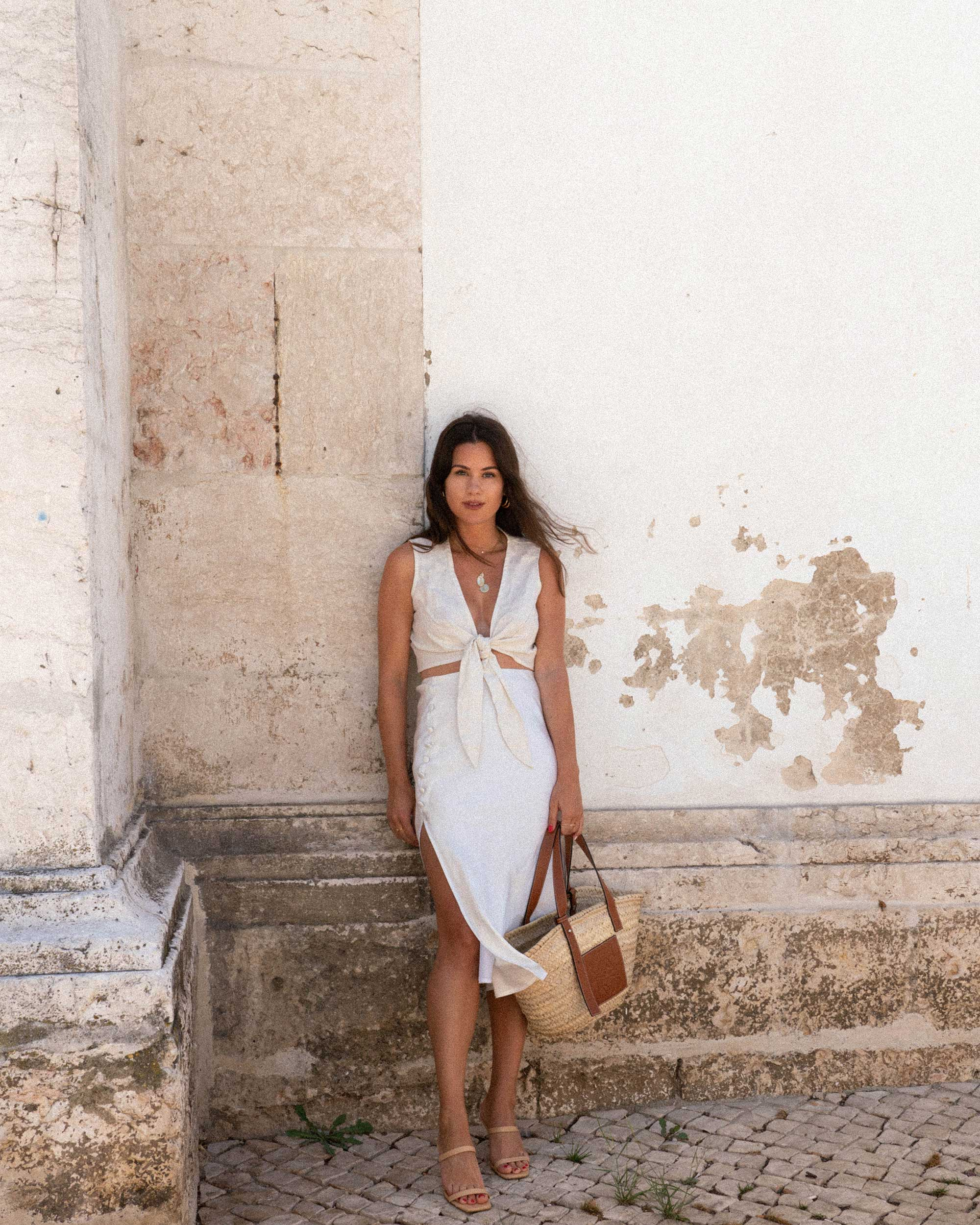 Shades of Portugal - Summering in Lisbon, Portugal wearing Faithfull the Brand Marcie plunging cropped tie top and Loewe raffia basket tote bag for the perfect hot-weather outfit.