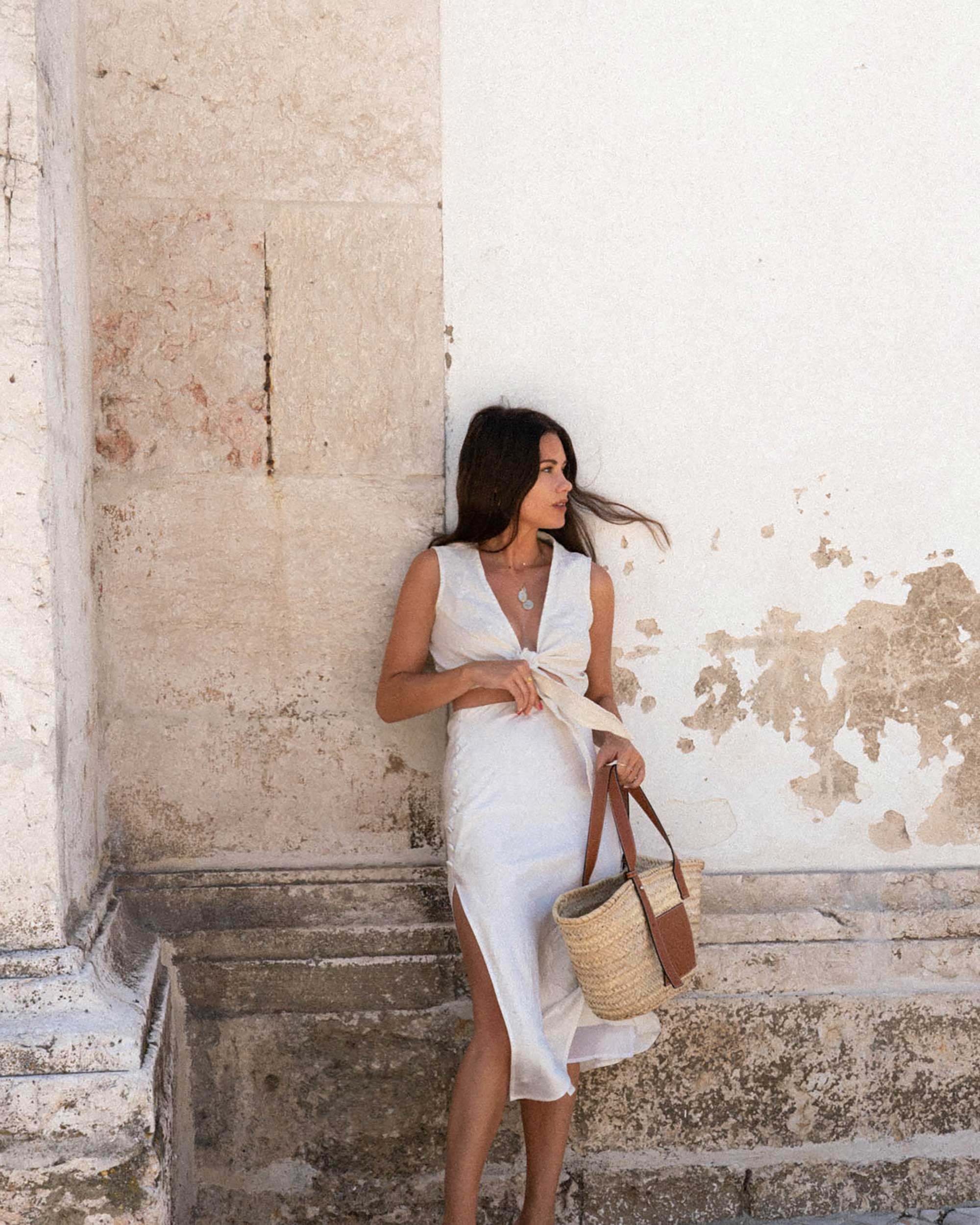 Sarah Butler of Sarah Styles Seattle wears Faithfull the Brand Marcie Plunging Cropped Tie Top and Loewe Raffia Basket Tote Bag in Lisbon, Portugal | @sarahchristine -1.jpg