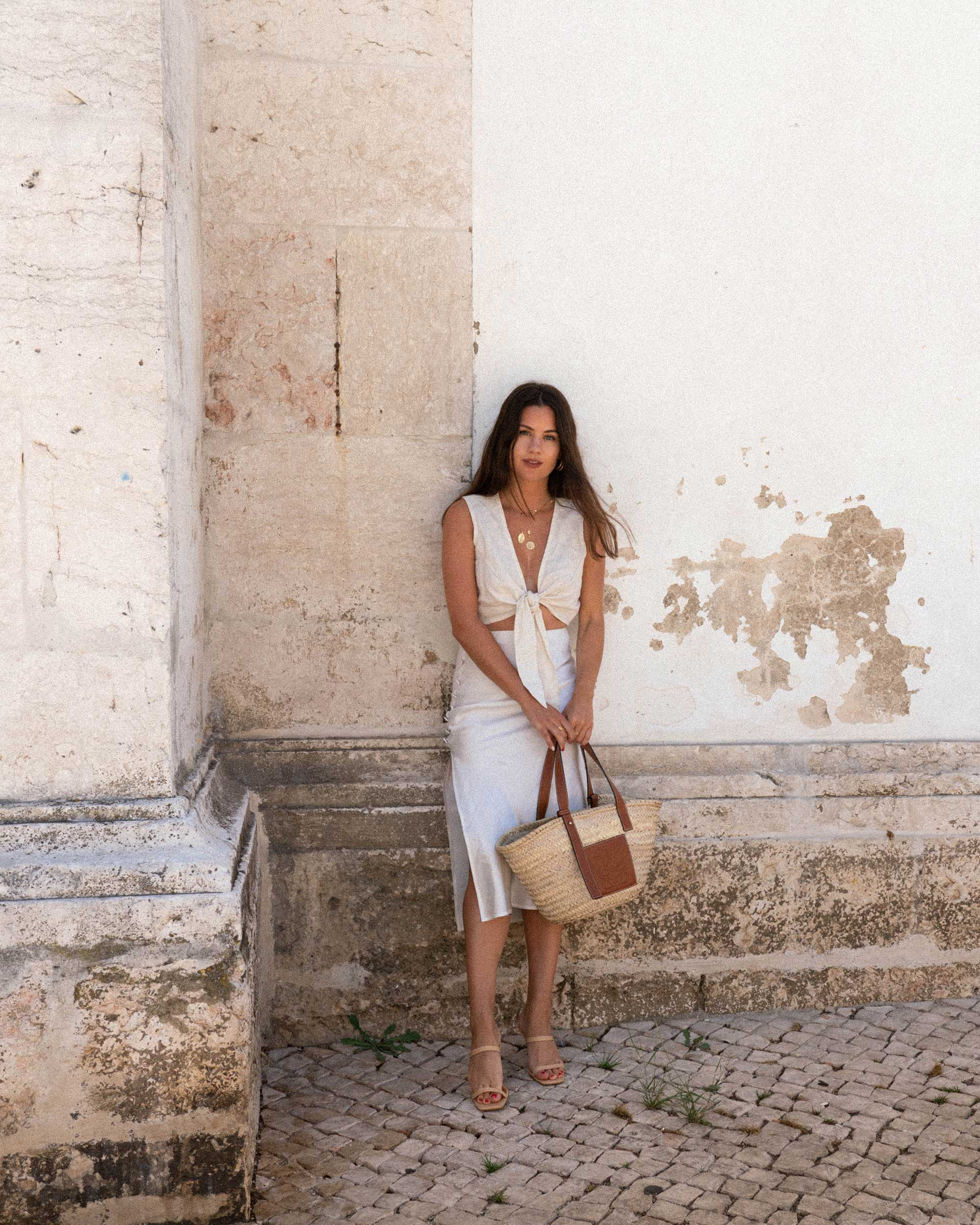 Sarah Butler of Sarah Styles Seattle wears Faithfull the Brand Marcie Plunging Cropped Tie Top and Loewe Raffia Basket Tote Bag in Lisbon, Portugal | @sarahchristine -7.jpg