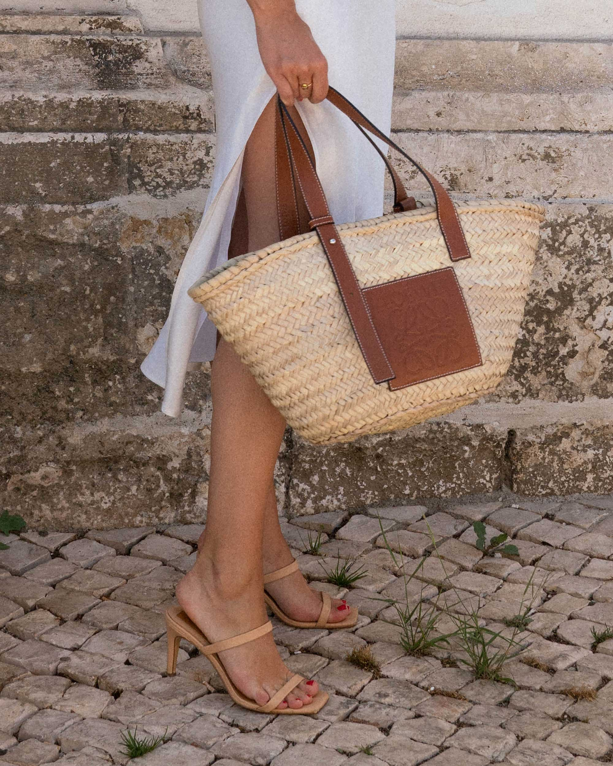 Sarah Butler of Sarah Styles Seattle wears Faithfull the Brand Marcie Plunging Cropped Tie Top and Loewe Raffia Basket Tote Bag in Lisbon, Portugal | @sarahchristine - 8.jpg