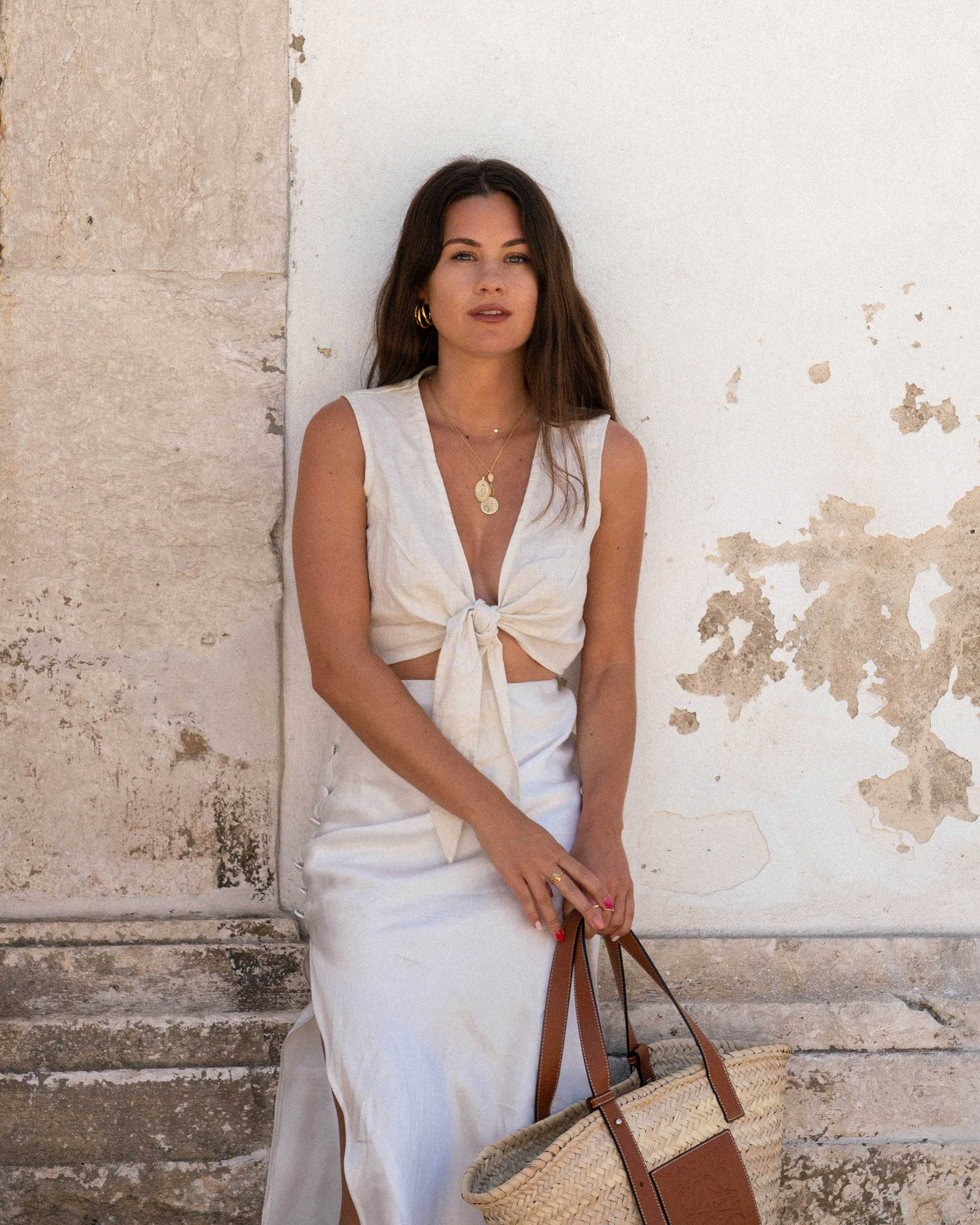 Sarah Butler of Sarah Styles Seattle wears Faithfull the Brand Marcie Plunging Cropped Tie Top and Loewe Raffia Basket Tote Bag in Lisbon, Portugal | @sarahchristine - 1.jpg