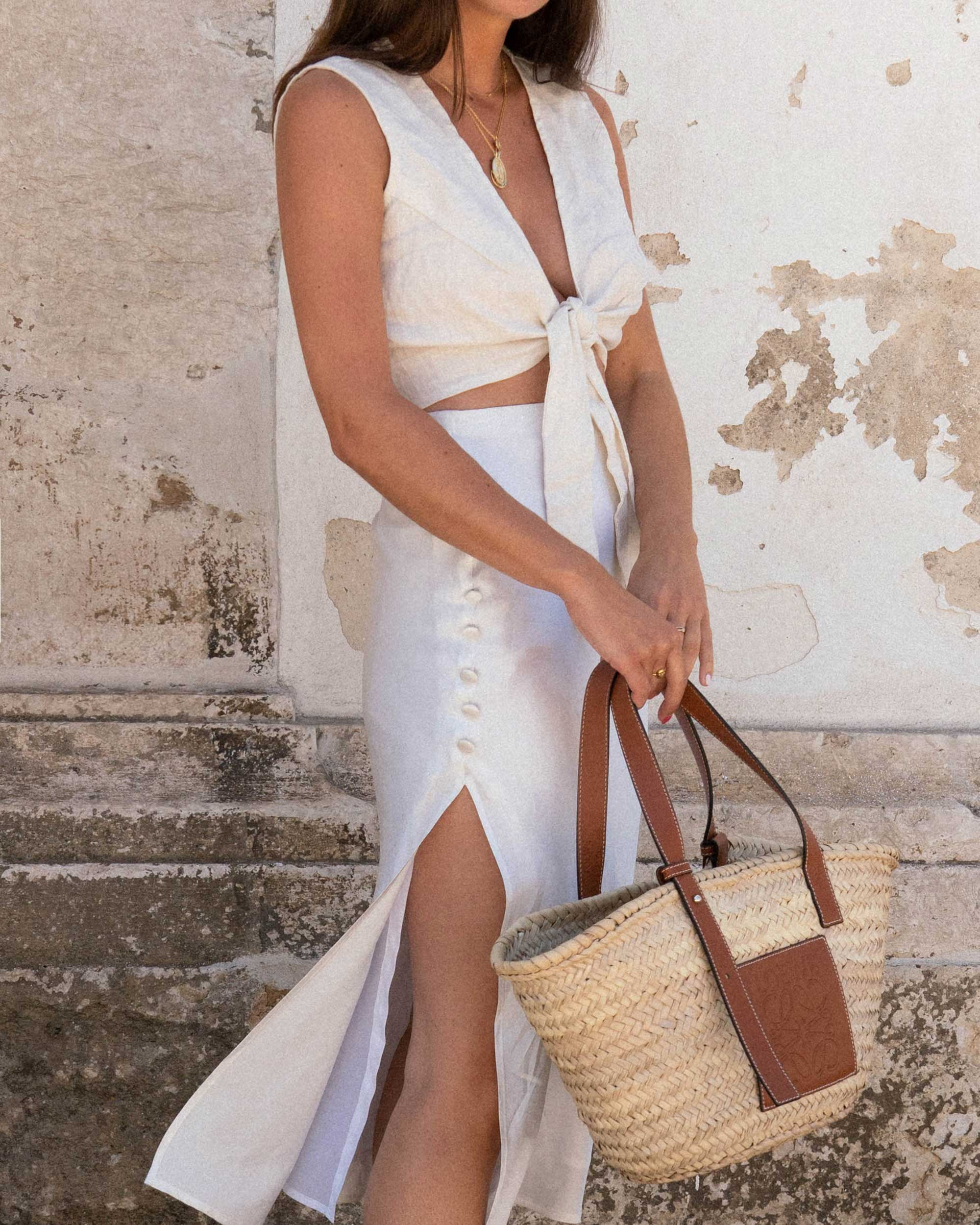 Sarah Butler of Sarah Styles Seattle wears Faithfull the Brand Marcie Plunging Cropped Tie Top and Loewe Raffia Basket Tote Bag in Lisbon, Portugal | @sarahchristine - 4.jpg