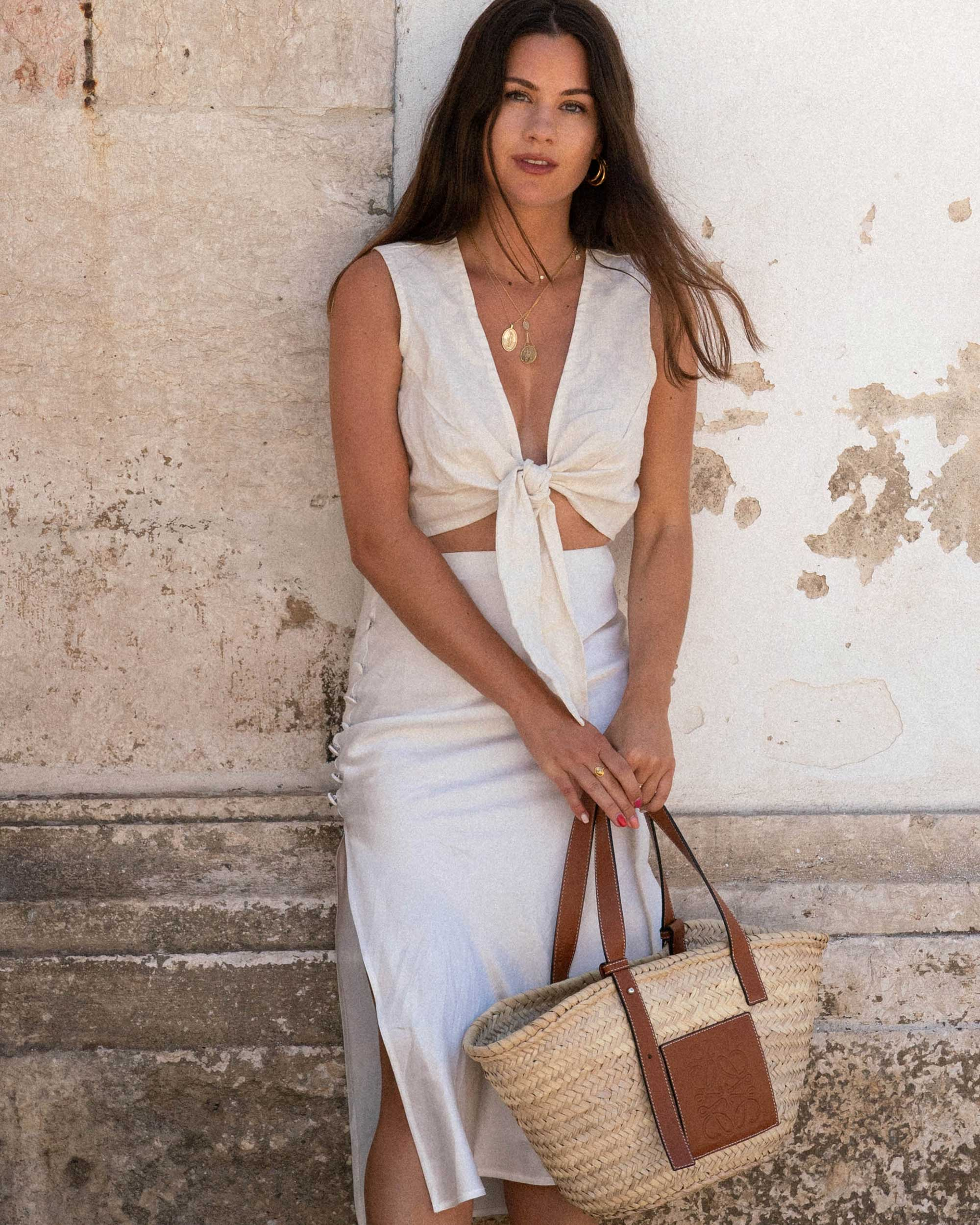 Sarah Butler of Sarah Styles Seattle wears Faithfull the Brand Marcie Plunging Cropped Tie Top and Loewe Raffia Basket Tote Bag in Lisbon, Portugal | @sarahchristine - 5.jpg