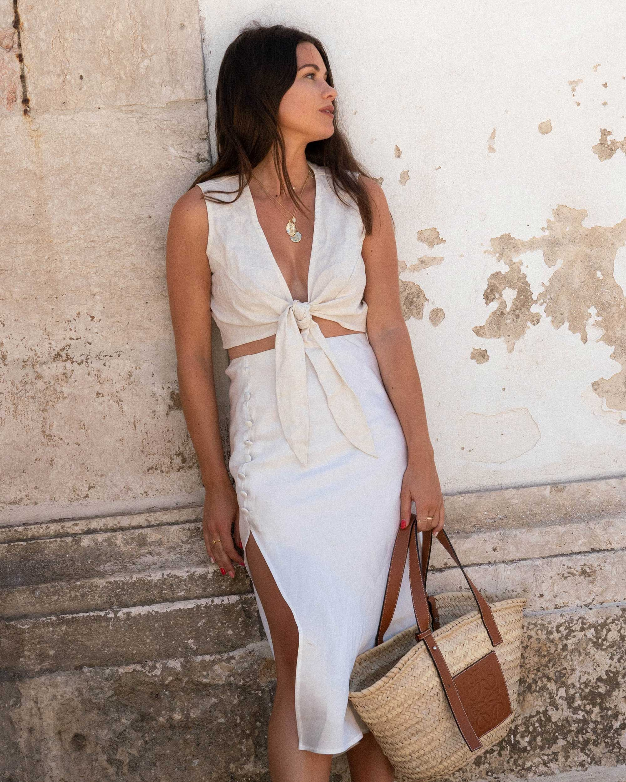 Sarah Butler of Sarah Styles Seattle wears Faithfull the Brand Marcie Plunging Cropped Tie Top and Loewe Raffia Basket Tote Bag in Lisbon, Portugal | @sarahchristine - 6.jpg