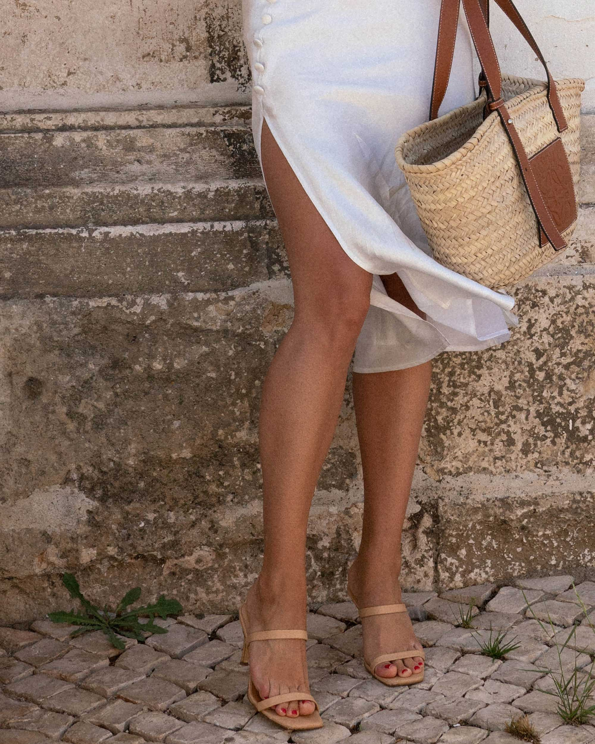Sarah Butler of Sarah Styles Seattle wears Faithfull the Brand Marcie Plunging Cropped Tie Top and Loewe Raffia Basket Tote Bag in Lisbon, Portugal | @sarahchristine -9.jpg