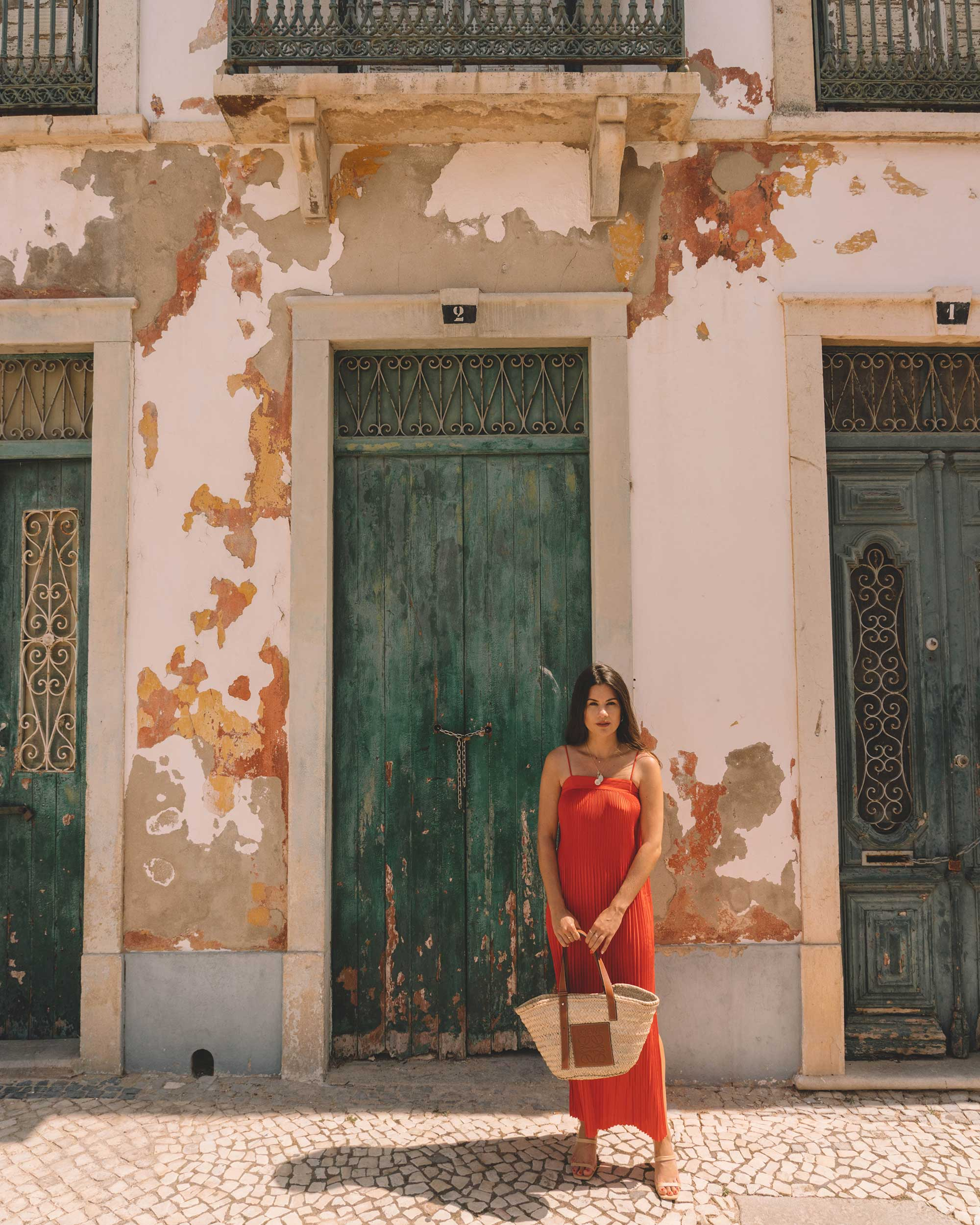 Red in Portugal - Ready for Sangria in & Other Stories red pleated midi dress with a square cut, spaghetti straps and plisse detailing in Lisbon, Portugal.
