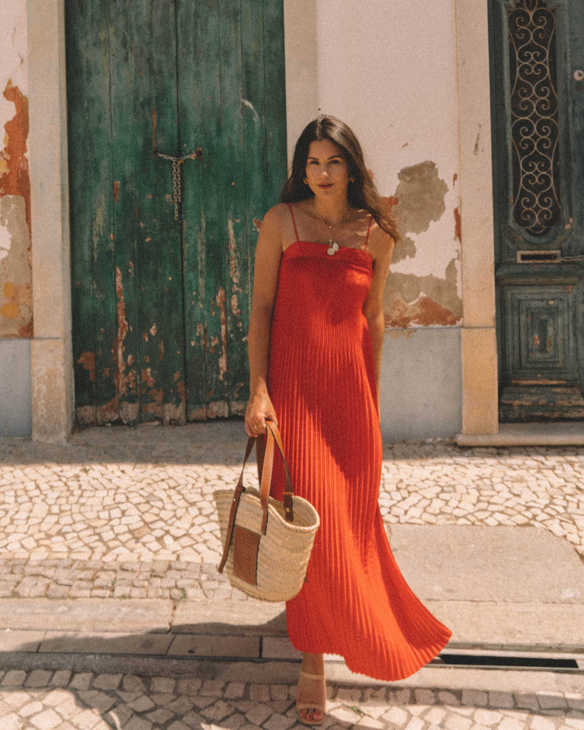 Sarah Butler of Sarah Styles Seattle wears And Other Stories red pleated midi dress with a square cut, spaghetti straps and plisse detailing in Lisbon, Portugal | @sarahchristine -5.jpg