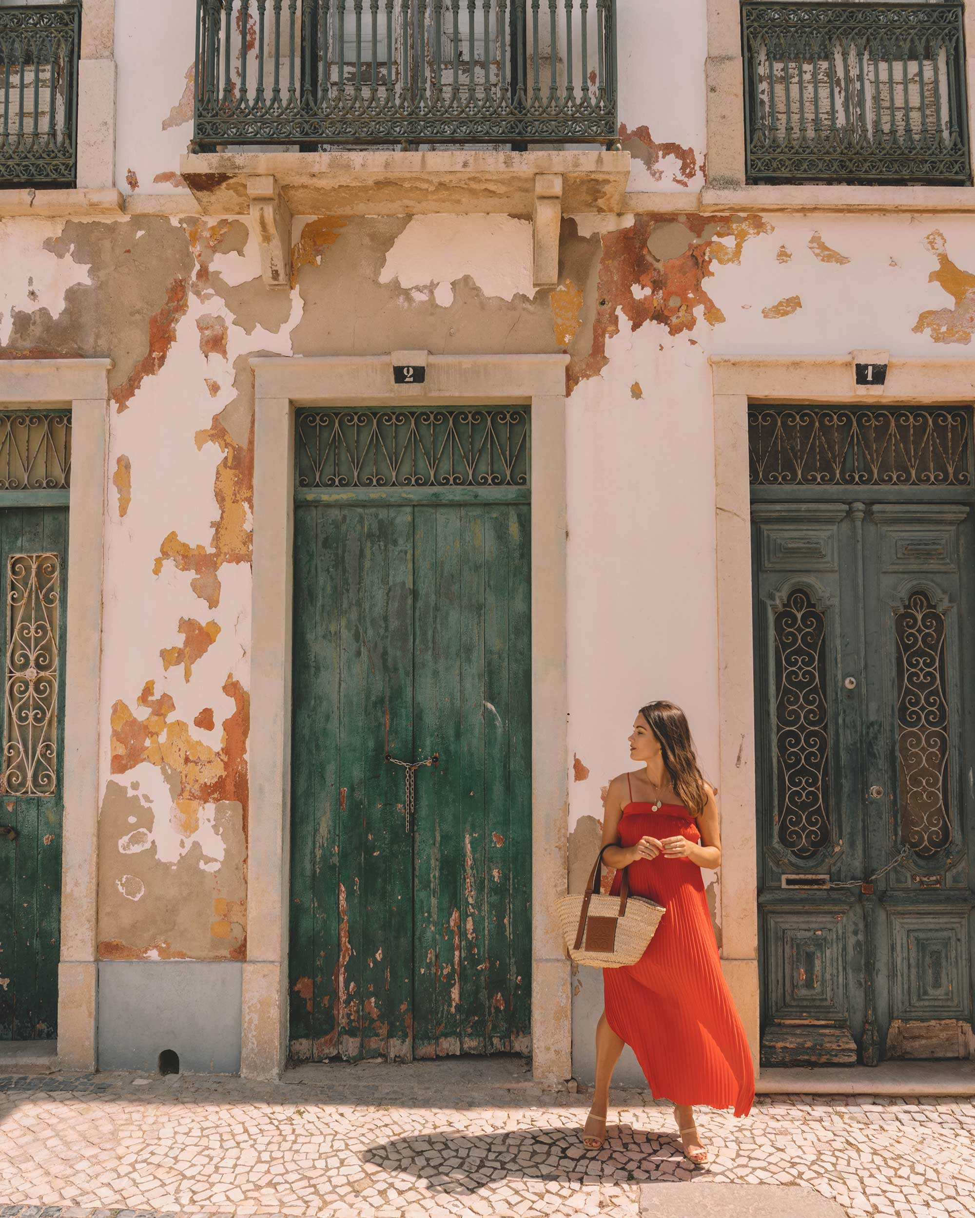Sarah Butler of Sarah Styles Seattle wears And Other Stories red pleated midi dress with a square cut, spaghetti straps and plisse detailing in Lisbon, Portugal | @sarahchristine -2.jpg