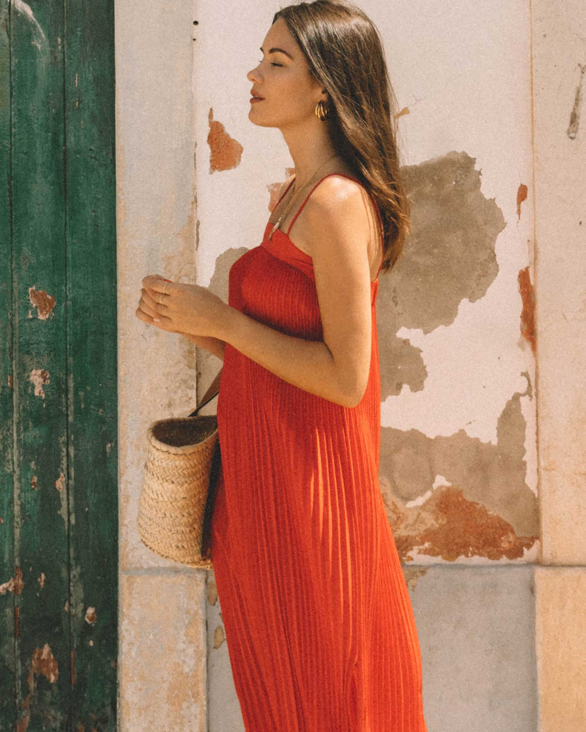 Sarah Butler of Sarah Styles Seattle wears And Other Stories red pleated midi dress with a square cut, spaghetti straps and plisse detailing in Lisbon, Portugal | @sarahchristine -4.jpg