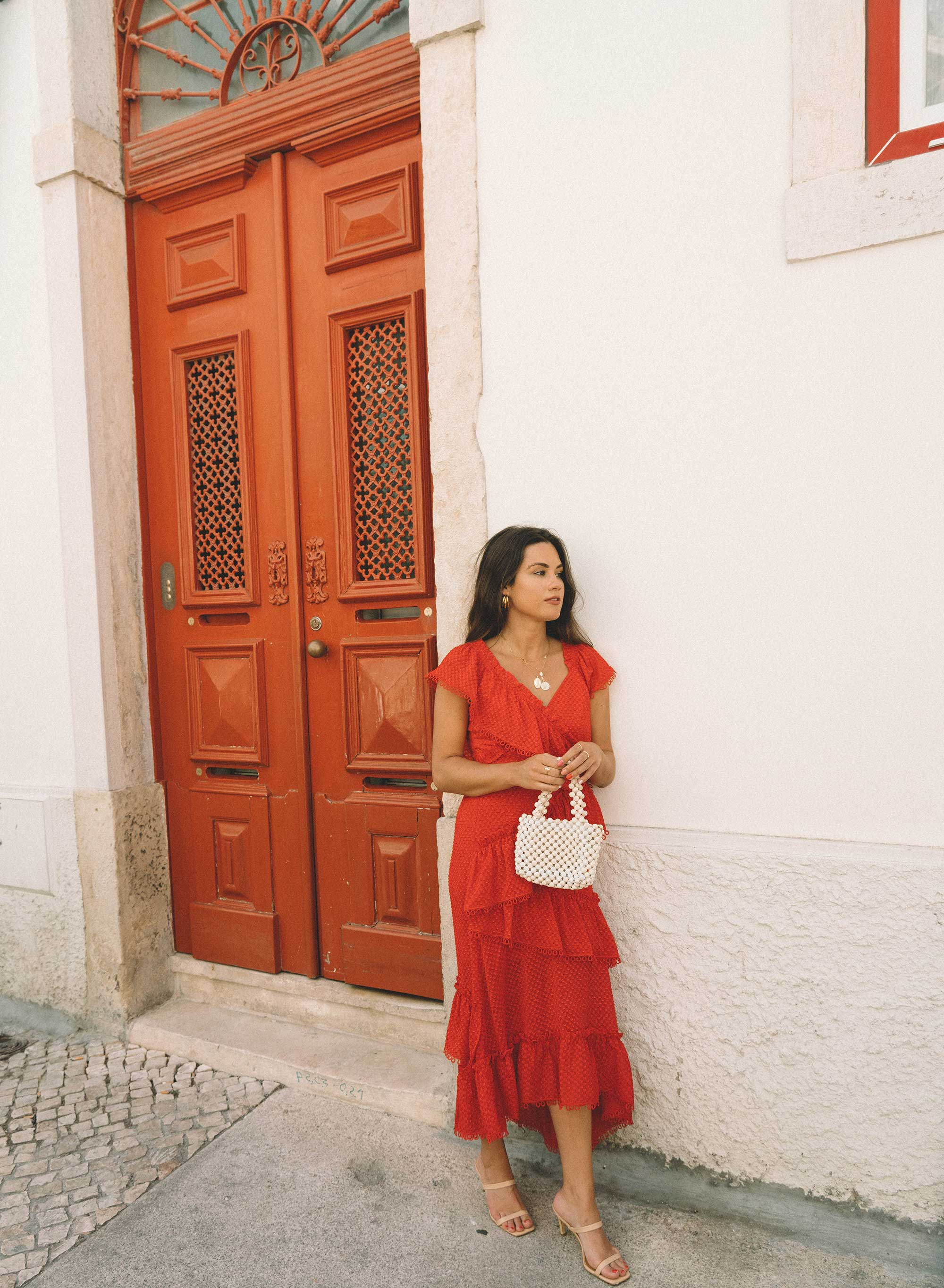 Afternoon in Lisbon - A beautiful afternoon in Lisbon, Portugal wearing Three Floor rouge tiered midi dress constructed with layered ruffles and an asymmetric hemline and Jagger two strap leather heel.