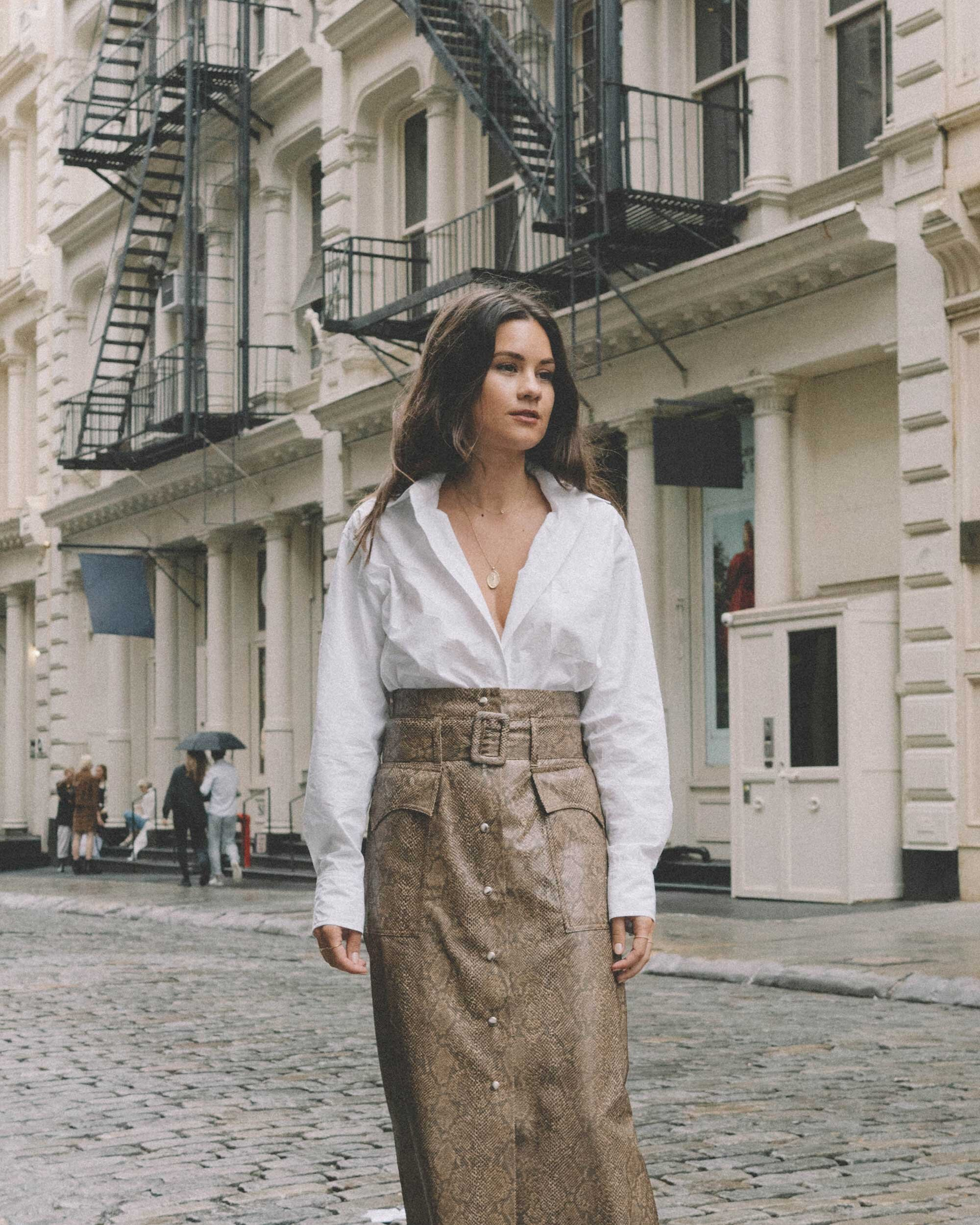 NYFW with Farfetch - Feeling fall in this look from Farfetch featuring Nanushka Aarohi python-print vegan leather midi skirt and Sies Marjan crinkle effect button-up shirt in Soho New York for fashion week.