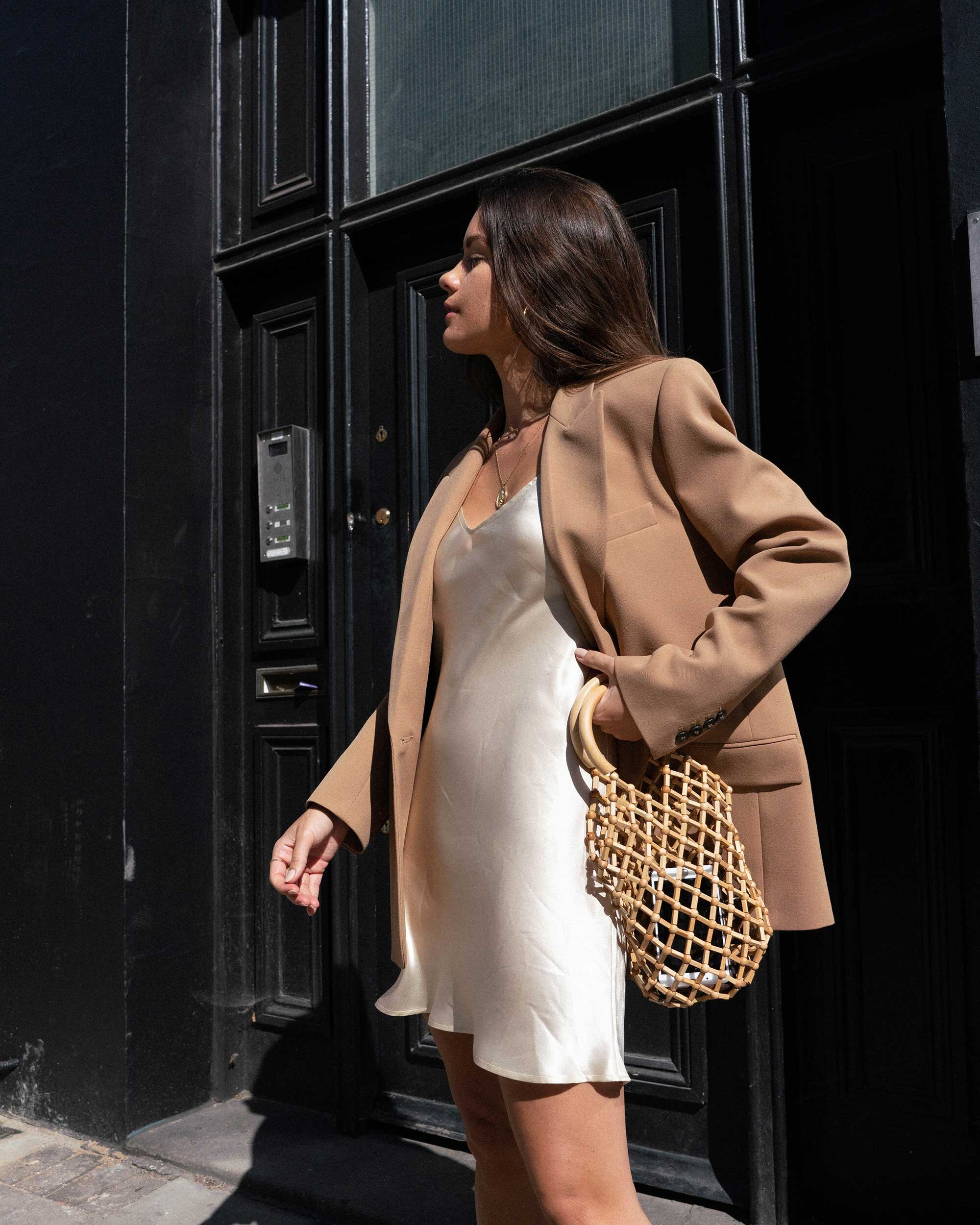 Blazer Weather - Out in London wearing ivory slip dress and tan blazer for the perfect fall outfit.