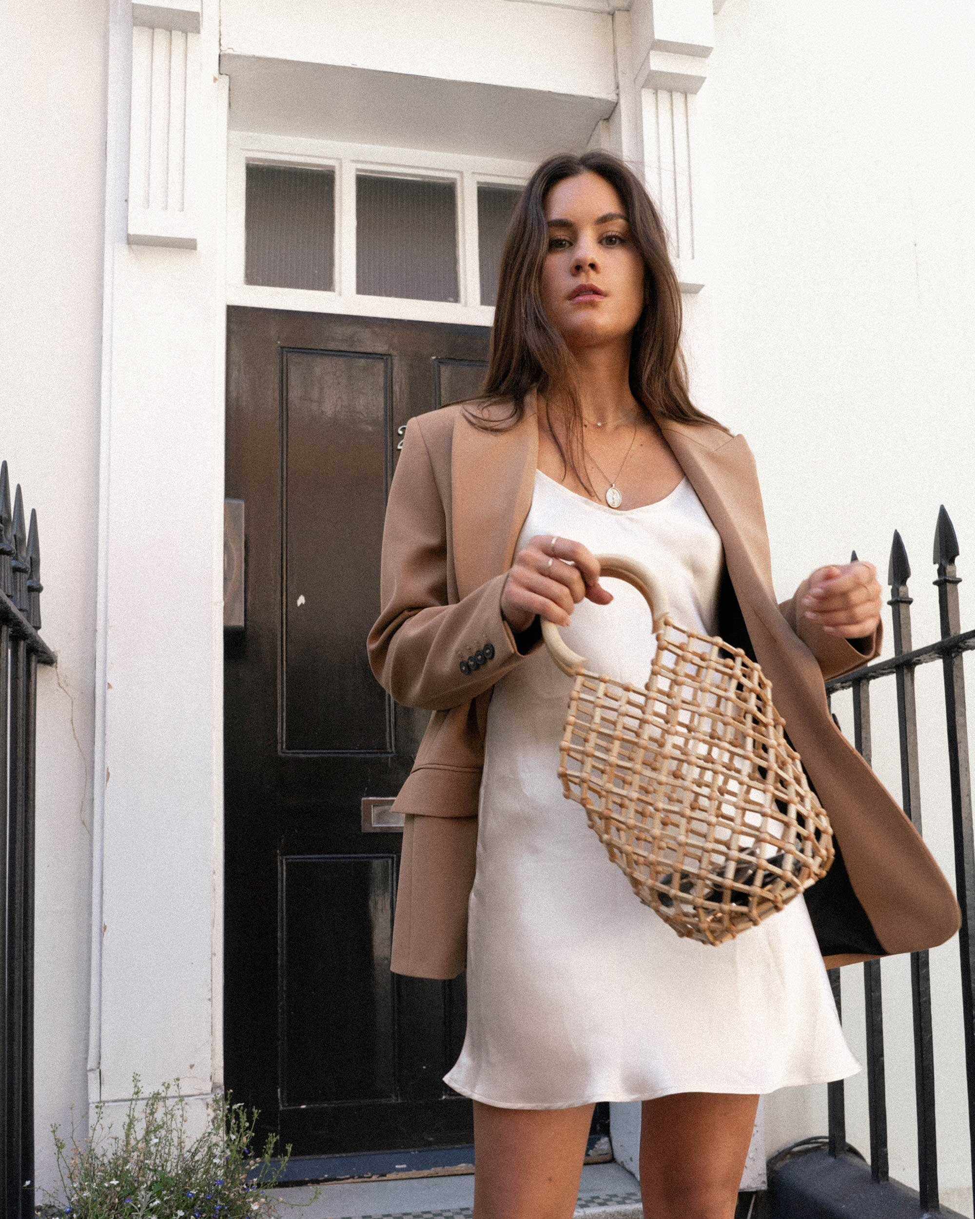 Sarah Butler of Sarah Styles Seattle wears ivory Slip dress and tan blazer in London | @sarahchristine -6.jpg