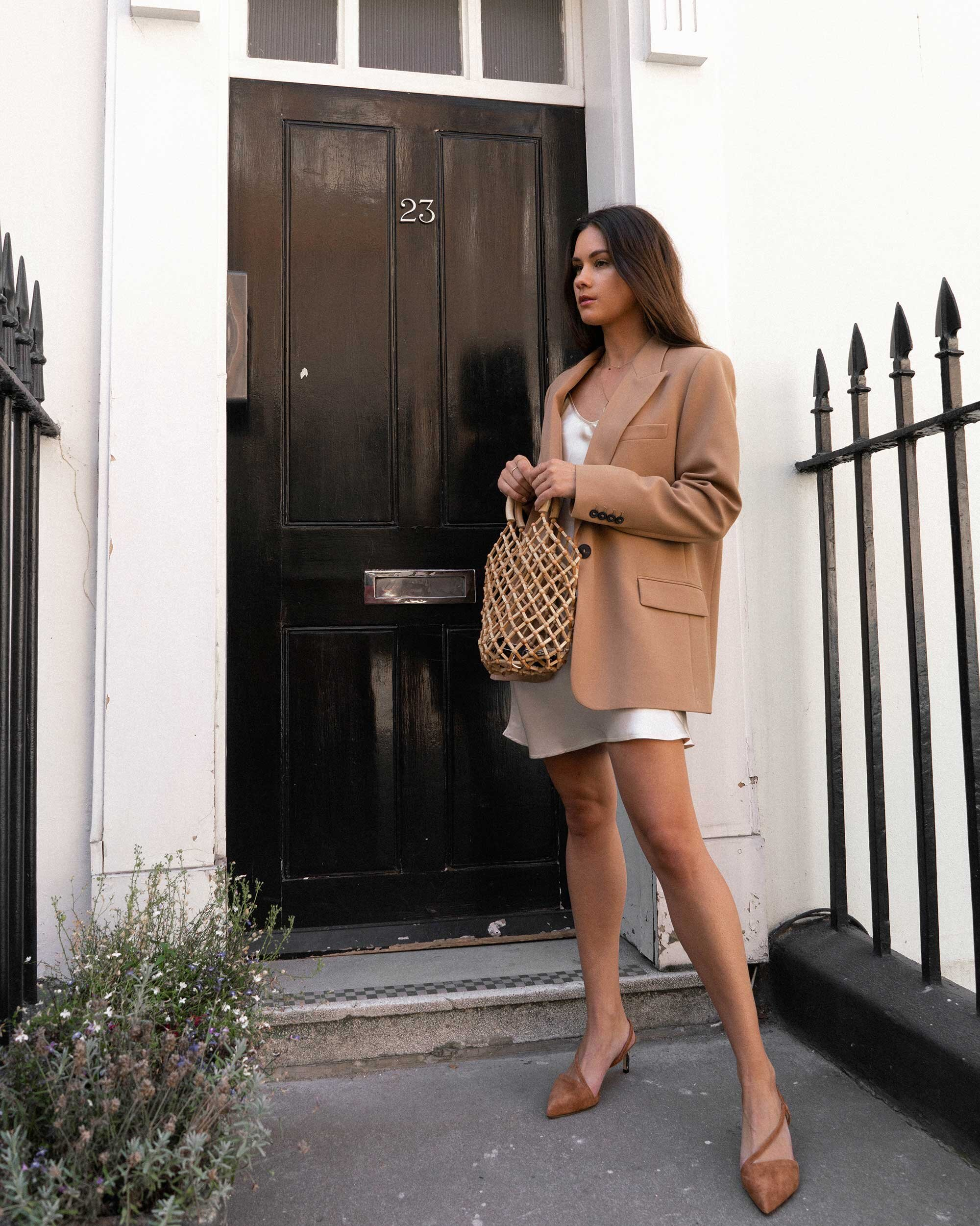 Sarah Butler of Sarah Styles Seattle wears ivory Slip dress and tan blazer in London | @sarahchristine -3.jpg